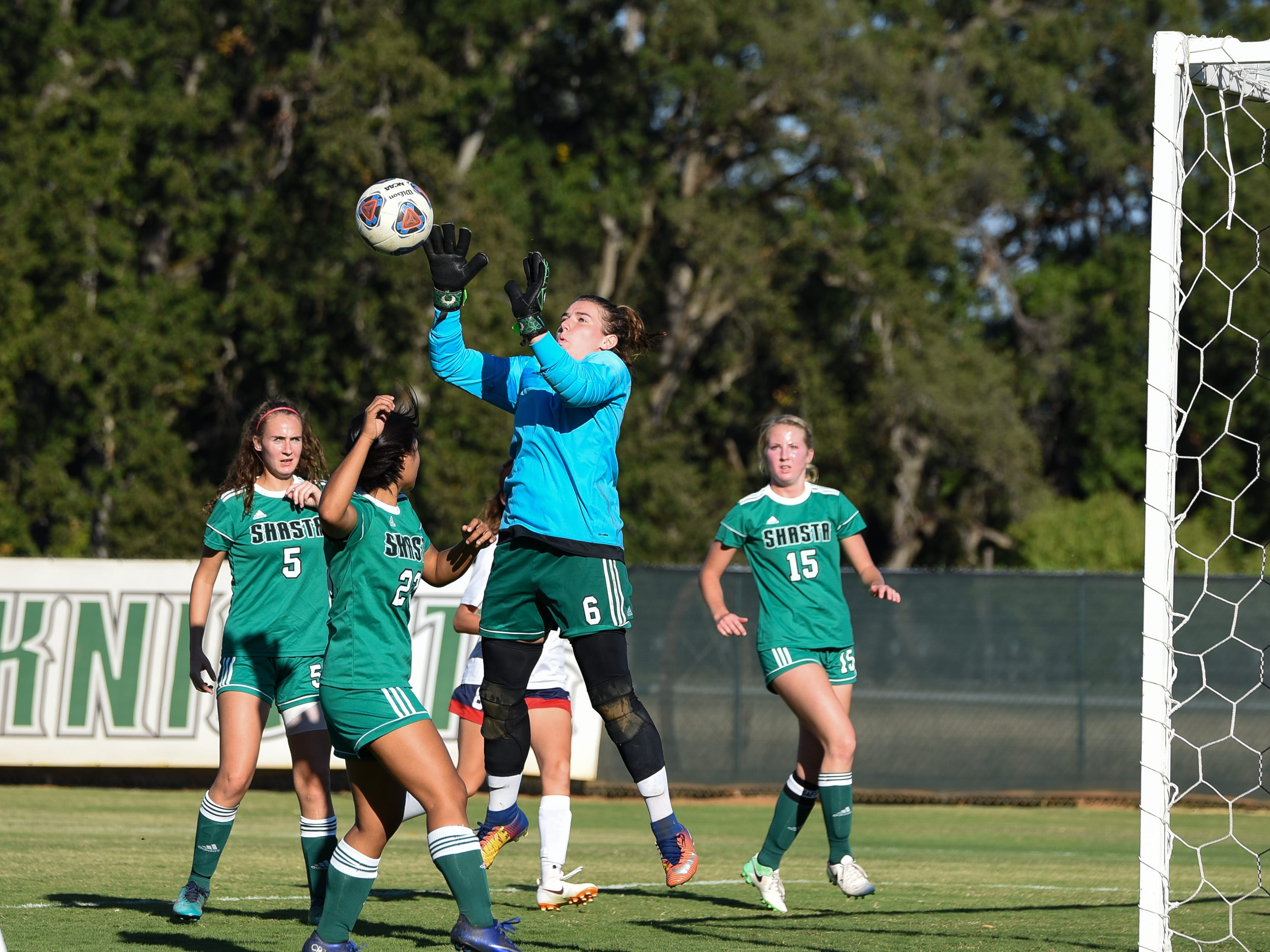 Shasta College goalie Bethany Sather goes to grab the ball during the Knights' 1-1 tie against College of the Siskiyous on Friday, Oct. 12, 2018.