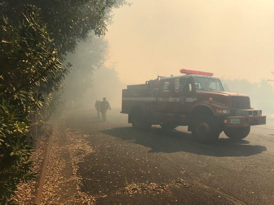 This was the scene on Sunday, Oct. 14, 2018 from the top of the hill where the Masonic Fire was approaching homes on Barbara Road at Nancy Court in Redding.