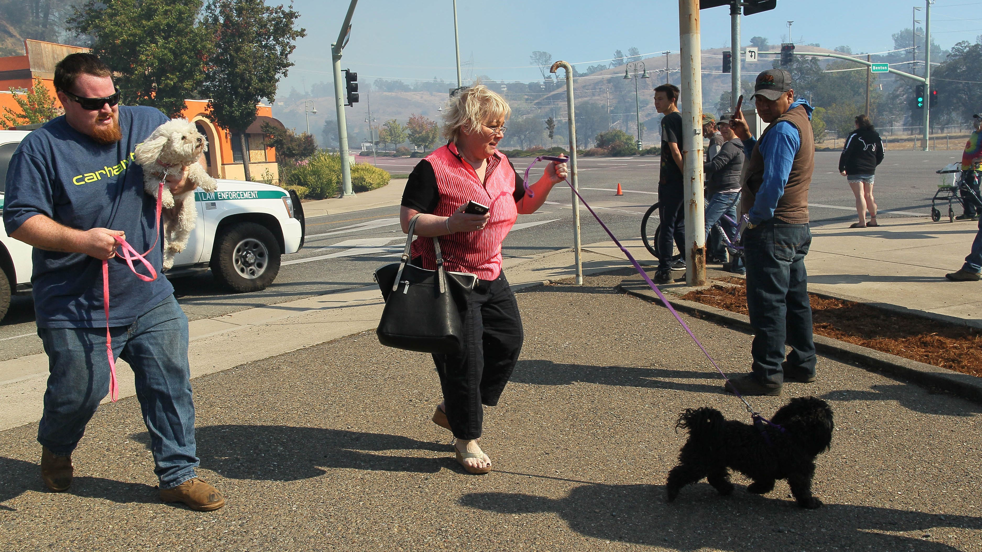 Evacuated residents from the Redding Heights subdivision rushed to safety with their dogs in the area of North Market Street at Benton Drive after the Masonic Fire broke out Sunday morning, Oct. 14, 2018 in the Sulphur Creek canyon. (Hung T. Vu/Special to the Record Searchlight)
