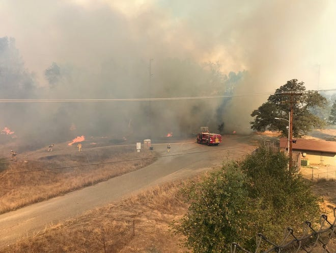 Strong winds pushed the Masonic Fire toward homes on the hill above Enron Drive in Redding. The area was being evacuated on Sunday, Oct. 14, 2018