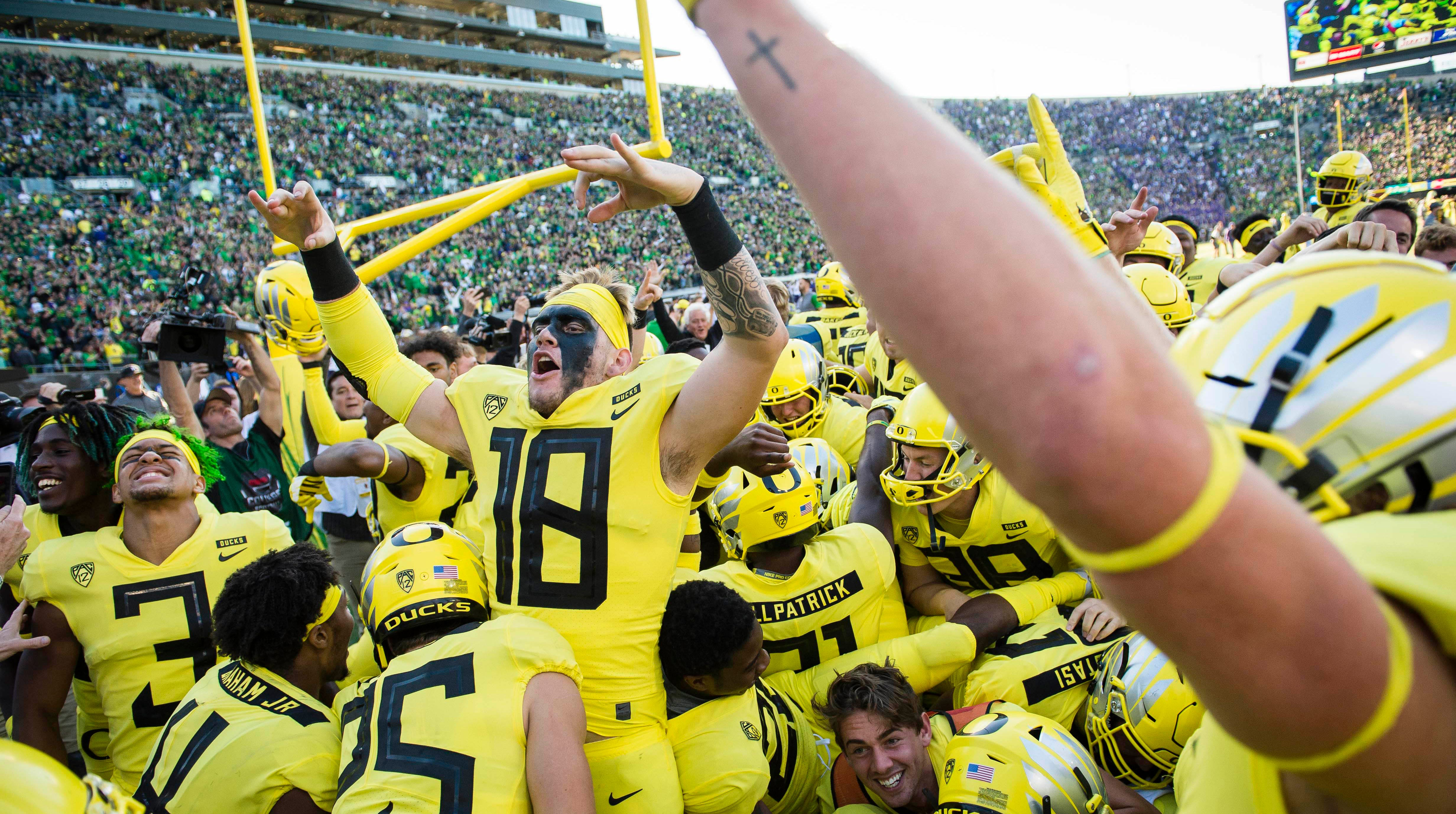 Oct 13, 2018; Eugene, OR, USA; The Oregon Ducks celebrate in the end zone after a game against Washington Huskies at Autzen Stadium. The Ducks won in overtime 30-27. Mandatory Credit: Troy Wayrynen-USA TODAY Sports