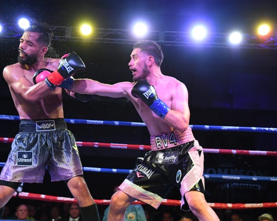 Ruben Villa IV (right) took Saturday night's fight via unanimous decision (80-72 from all scorers) for his 14th straight win to open his professional boxing career.