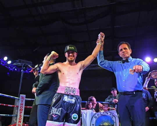 Local champion boxer Ruben Villa IV includes a BKM Healthy Foods' patch on his shorts and a hat with the Salinas health food store's logo.