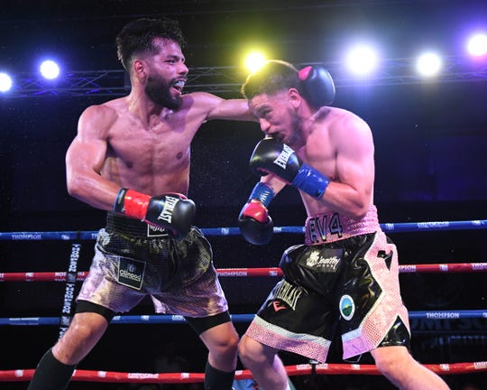 Ruben Villa IV's opponent, Miguel Carrizoza (left), was a tough outing for the young Salinas champion and made him work for the victory.