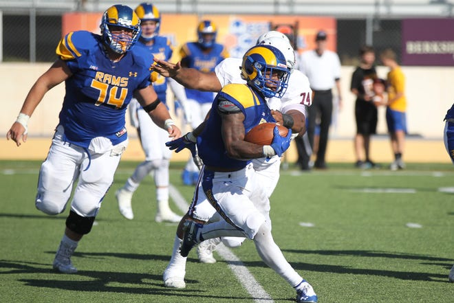 Angelo State University's Tyrese Nathan picks up some yards as A.J. Wozniack provides blocking during a Lone Star Conference football game against West Texas A&M at LeGrand Stadium at 1st Community Credit Union Field on Saturday, Oct. 13, 2018.