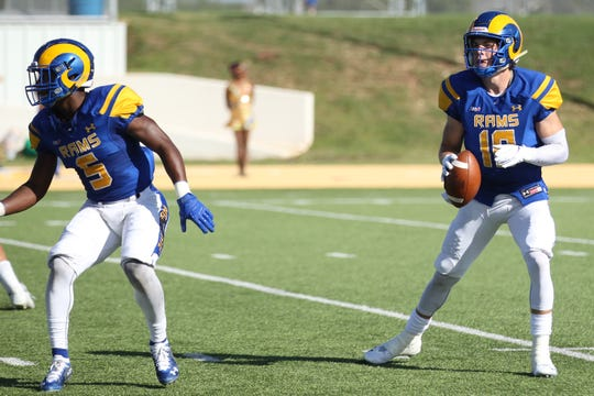 Angelo State University quarterback Payne Sullins looks for an open receiver as running back Tyrese Nathan gets ready to block during a Lone Star Conference football game against West Texas A&M at LeGrand Stadium at 1st Community Credit Union Field on Saturday, Oct. 13, 2018.