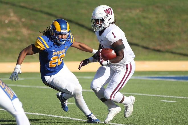 Angelo State University's Donavyn Jackson gets ready to tackle West Texas A&M's Duke Carter IV during a Lone Star Conference football game at LeGrand Stadium at 1st Community Credit Union Field on Saturday, Oct. 13, 2018. Jackson is a former San Angelo Central High School standout.