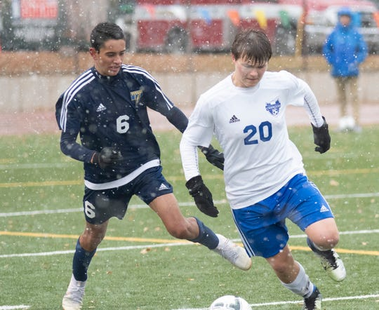 Sioux Falls Christian's Will Unruh dribbles the ball around Tea Area's Ryan Del Monaco.