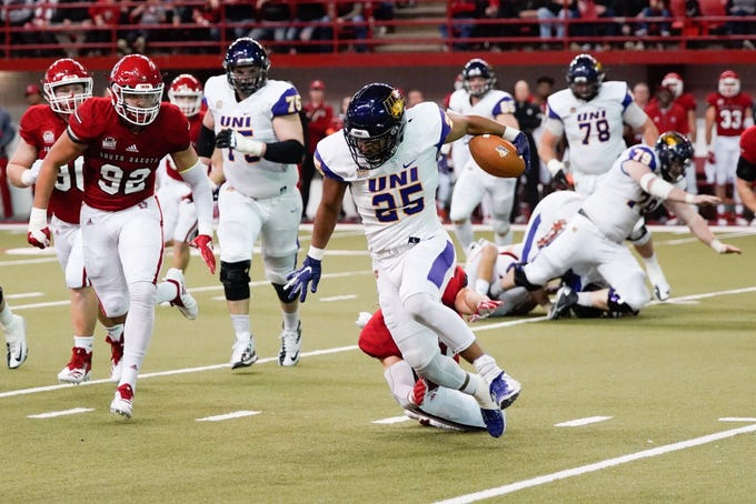 University of Northern Iowa looks to avoid a tackle on Saturday against the University of South Dakota on Saturday in Vermillion.