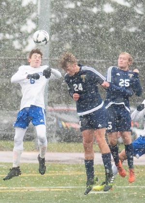 Tea Area's Brady Pfeifer (24) and Sioux Falls Christian's Matthew Bird battle for a header.