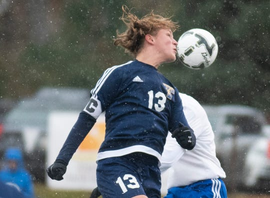 Tea Area's Micah Wimmer deflects a ball.