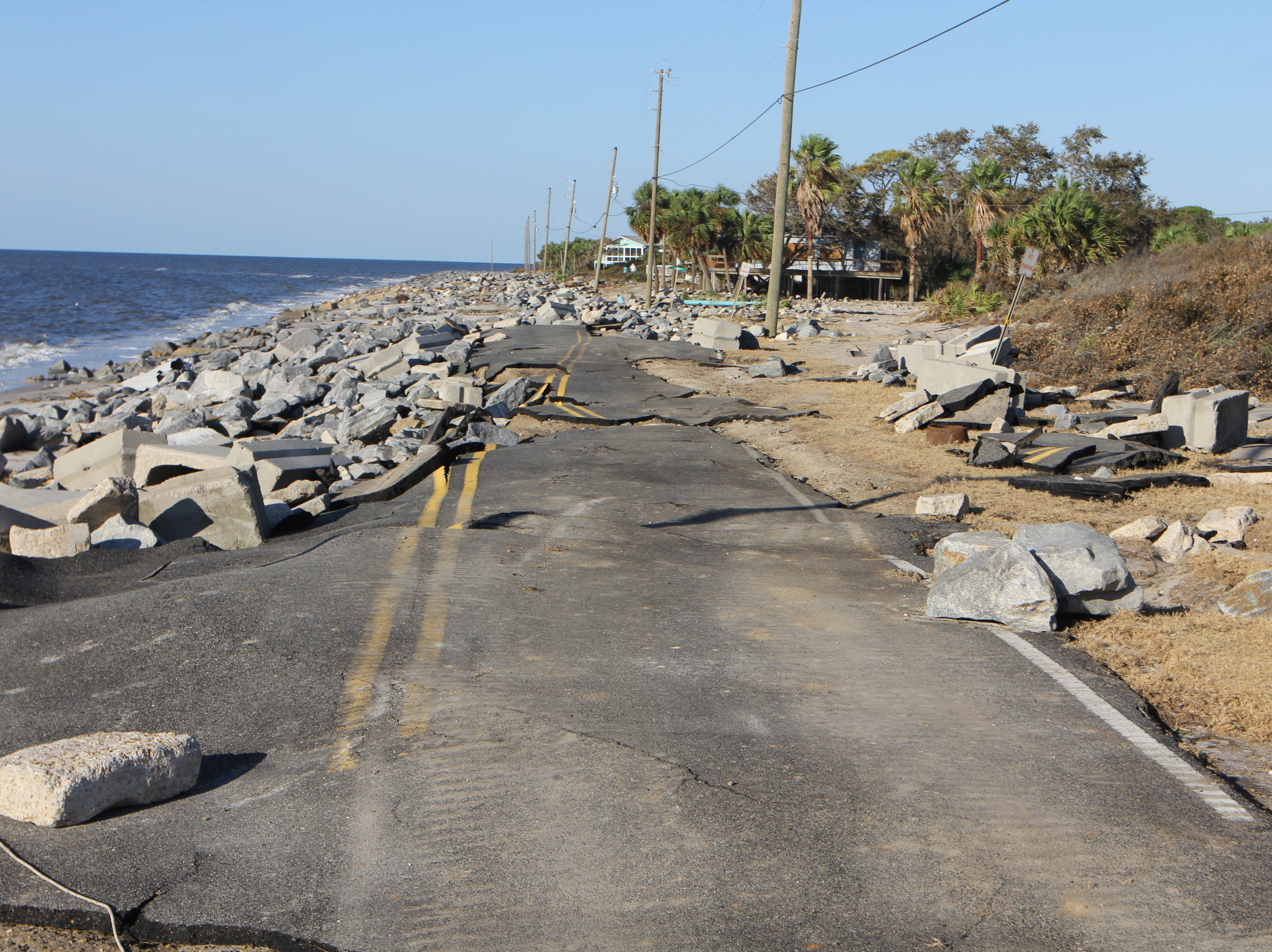 Debris litters the washed out main road to Alligator Point after Hurricane Michael.
