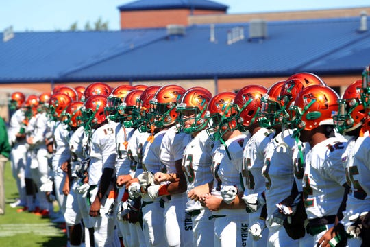 FAMU players locked in arms during pregame versus N.C. A&T.