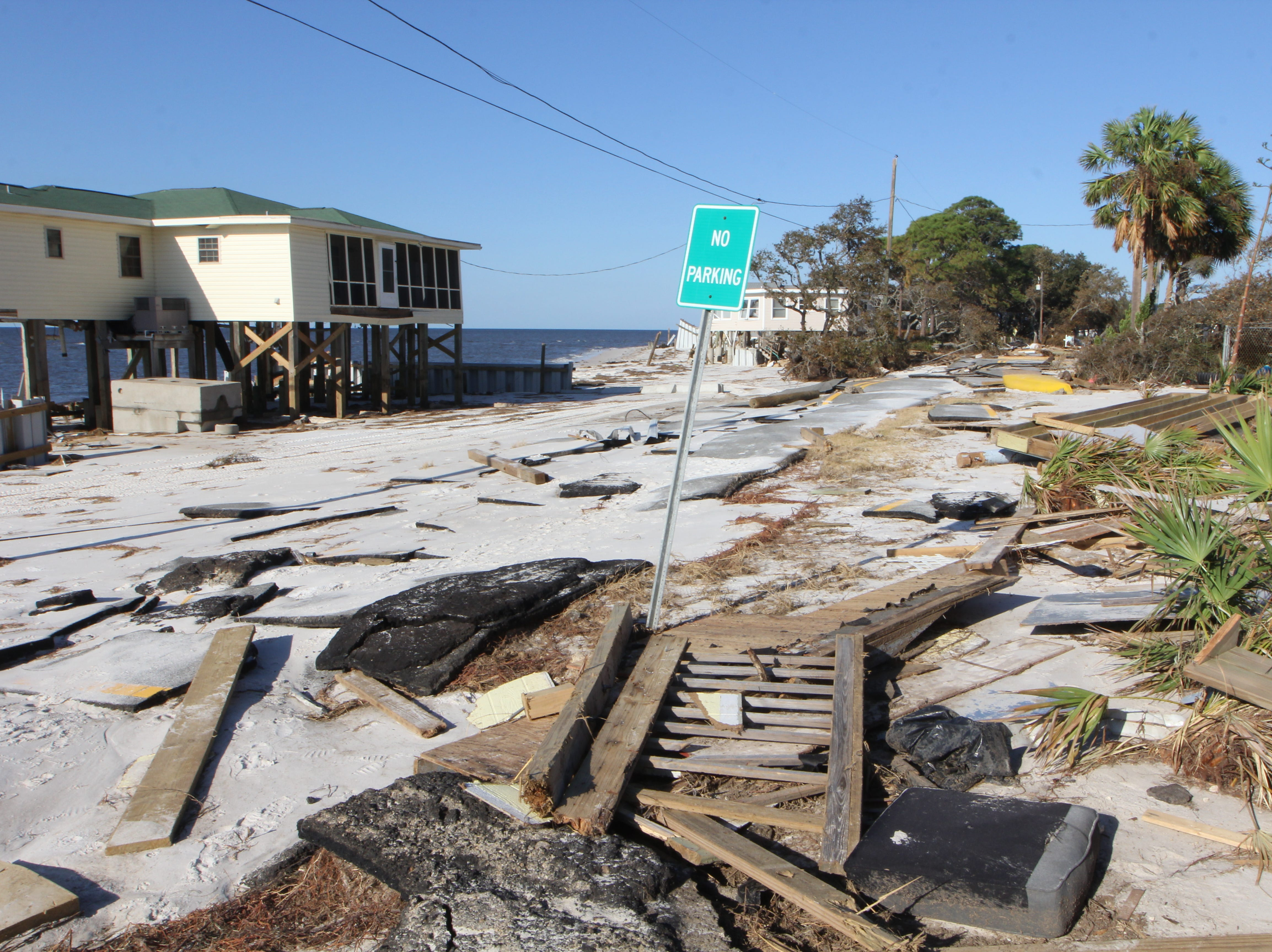 Rubble litters the roadway on Alligator Point after Hurricane Michael.