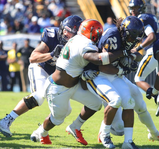 Renaldo Flowers makes a tackle against N.C. A&T's Marquell Cartwright. The Rattlers held the MEAC's leading rusher to 33 yards in a 22-21 win.