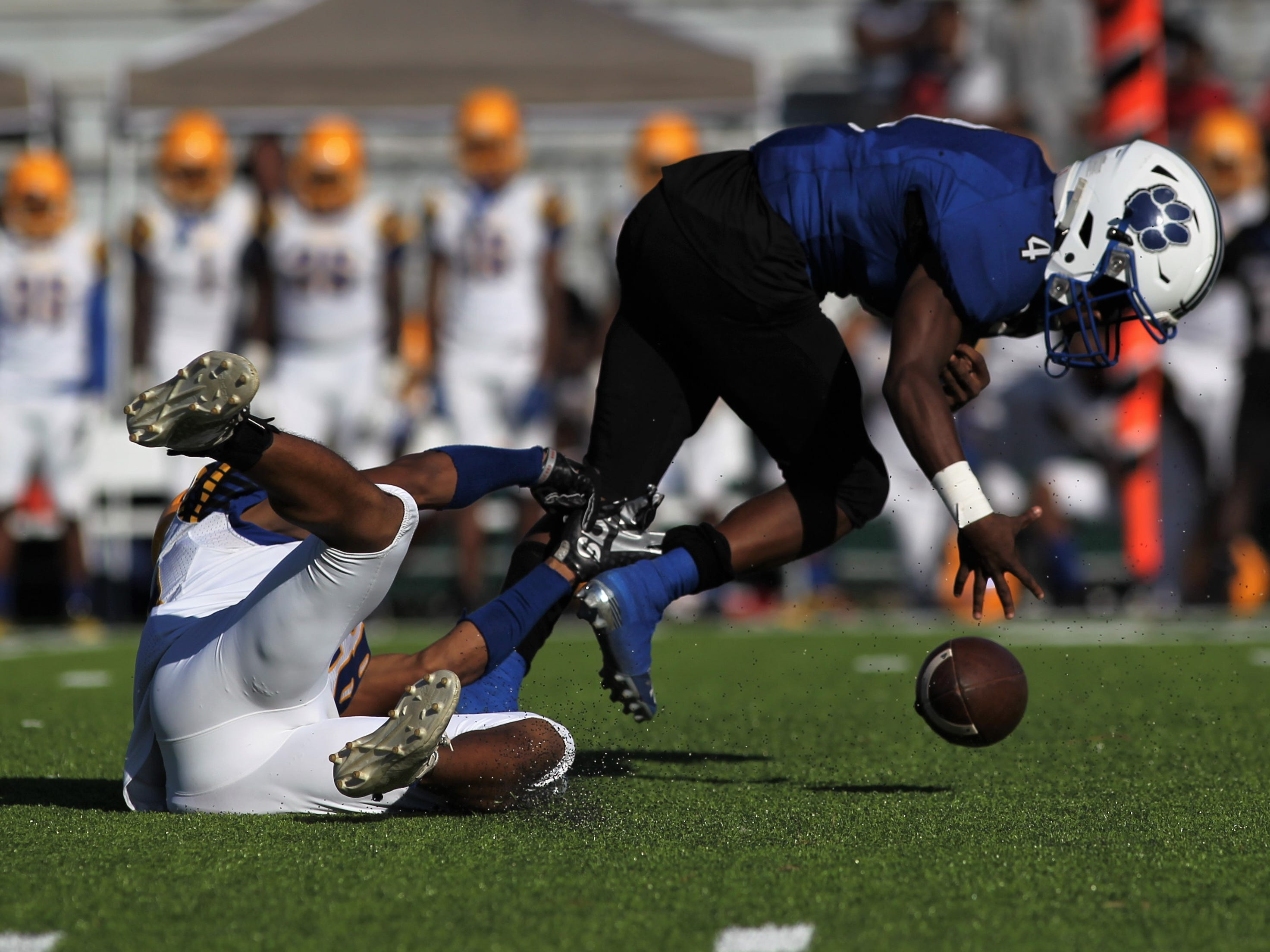 Godby receiver Alvin Jones can't hang onto a pass as he's tackled by a Rickards defender.