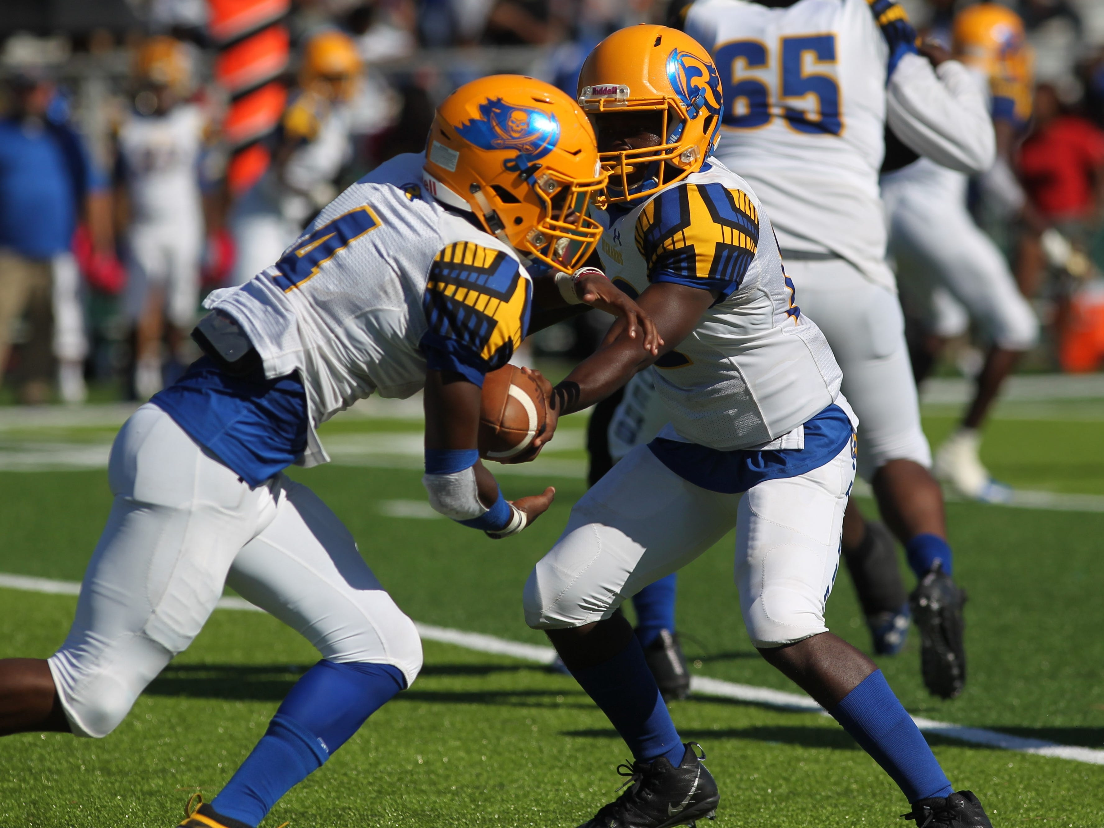 Rickards quarterback D'eryk Pete hands off to running back Kelvin Dean during Saturday's game against Godby.