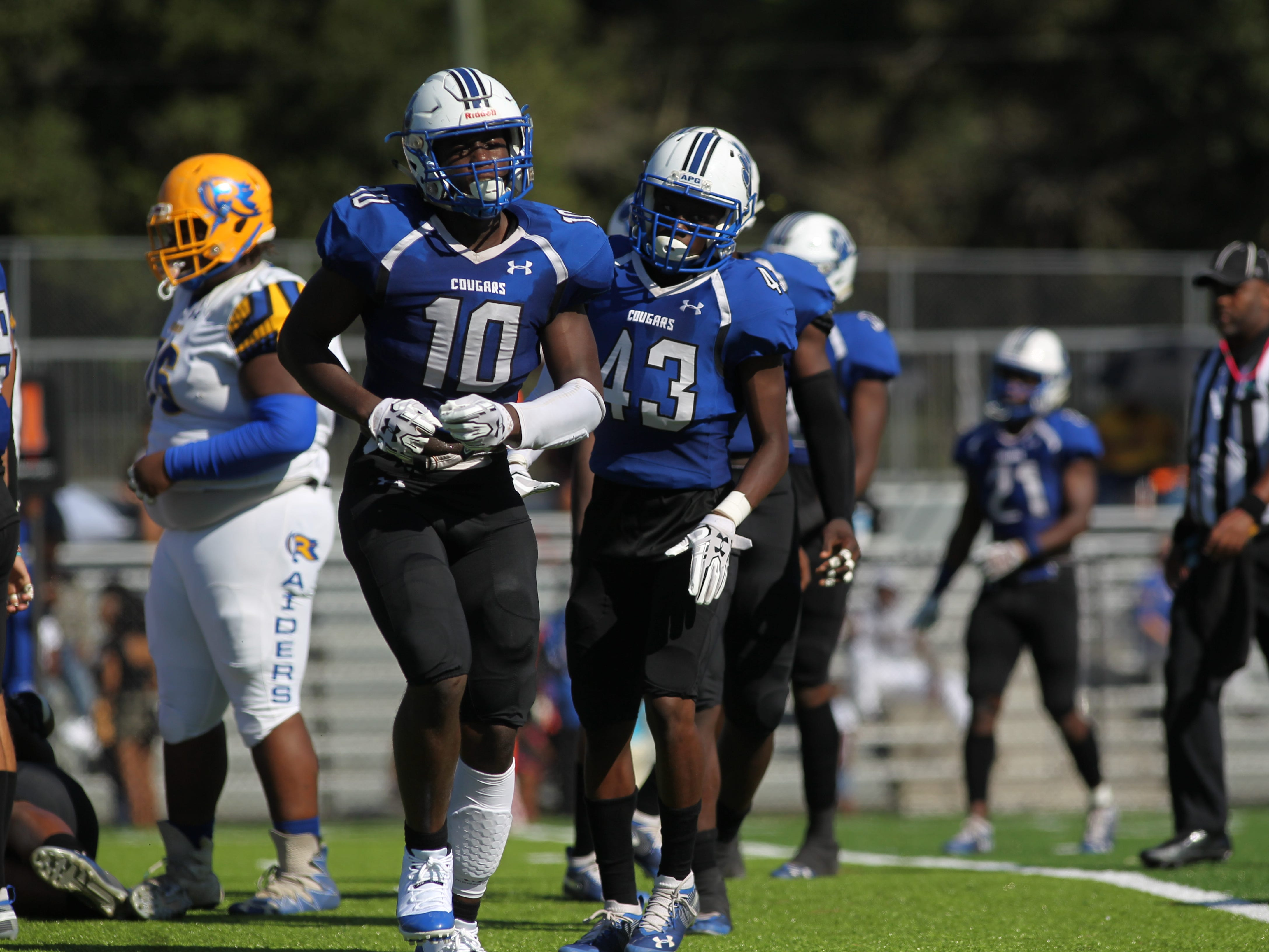 Godby's Cortez Andrews heads to the sideline after a sack against Rickards.