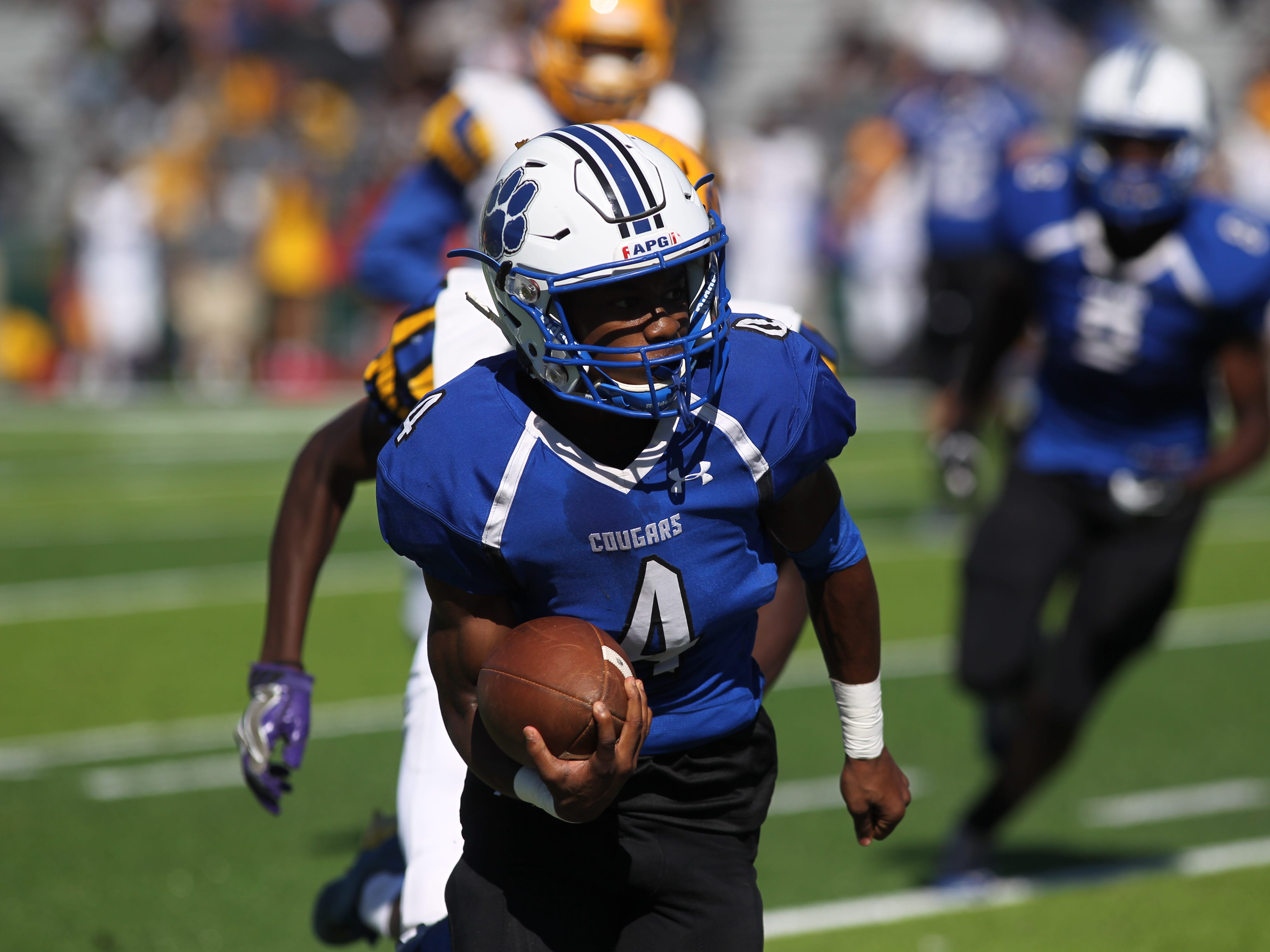 Godby receiver Alvin Jones breaks a 25-yard touchdown on a receiver screen during Saturday's win over Rickards.