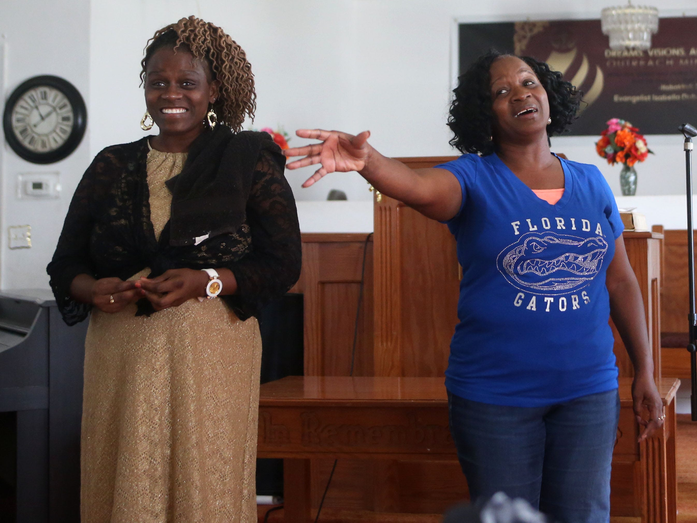 Jeanella Hall, 38, and Isabella Dubose, 54, aunts of Demashell Bass, a woman who could not receive medical attention and died during the hurricane speak at the Dream, Vision, and Destiny (DVD) Ministry in Gretna, Fla., on Sunday Oct. 14, 2018, after Hurricane Michael hits the Florida panhandle.