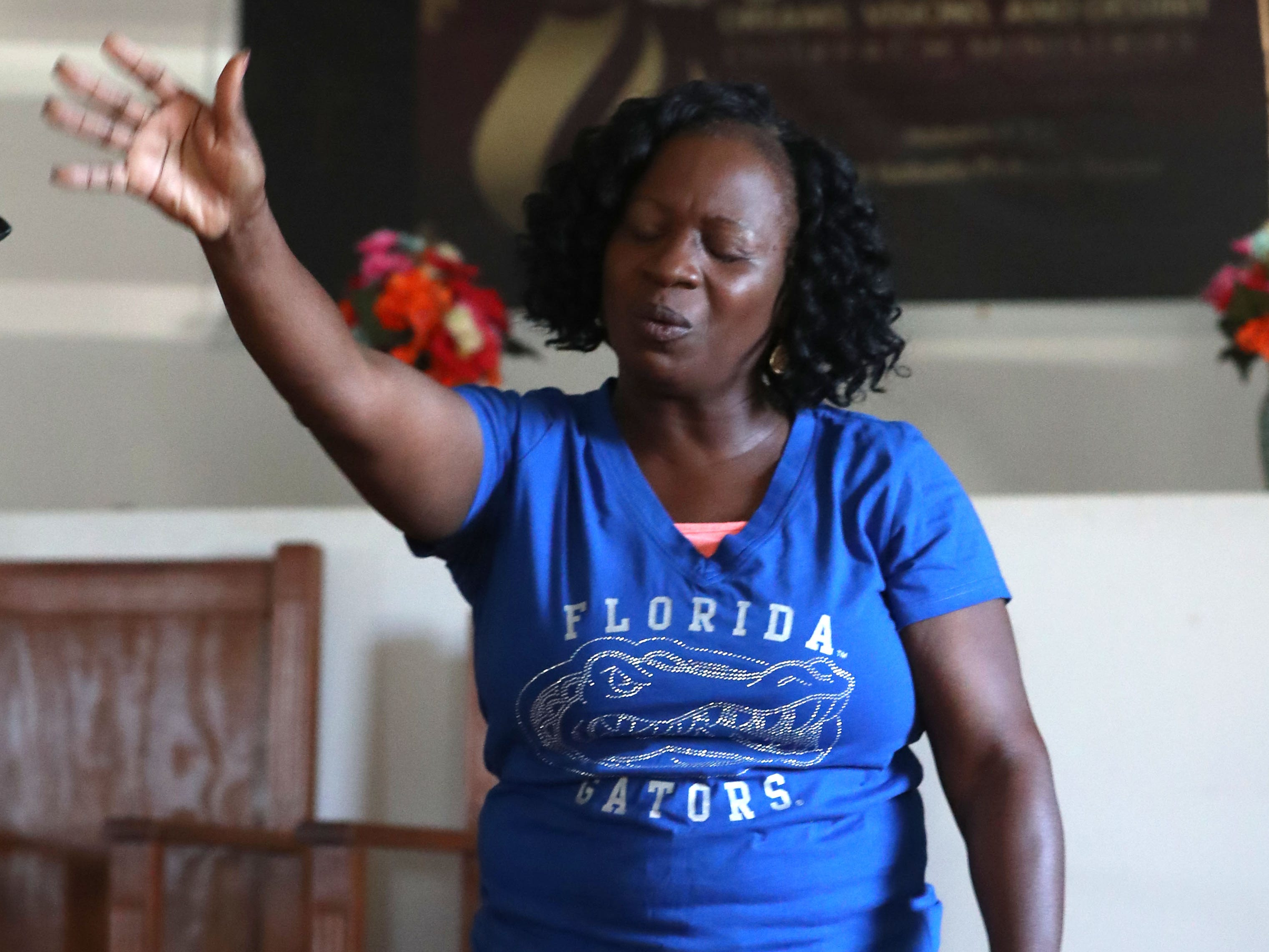 Isabella Dubose, aunt of Demashell Bass, a woman who could not receive medical attention and died during the hurricane, and pastor at the Dream, Vision, and Destiny (DVD) Ministry in Gretna, Fla., sings her praises at Sunday service on Oct. 14, 2018, after Hurricane Michael hits the Florida panhandle.