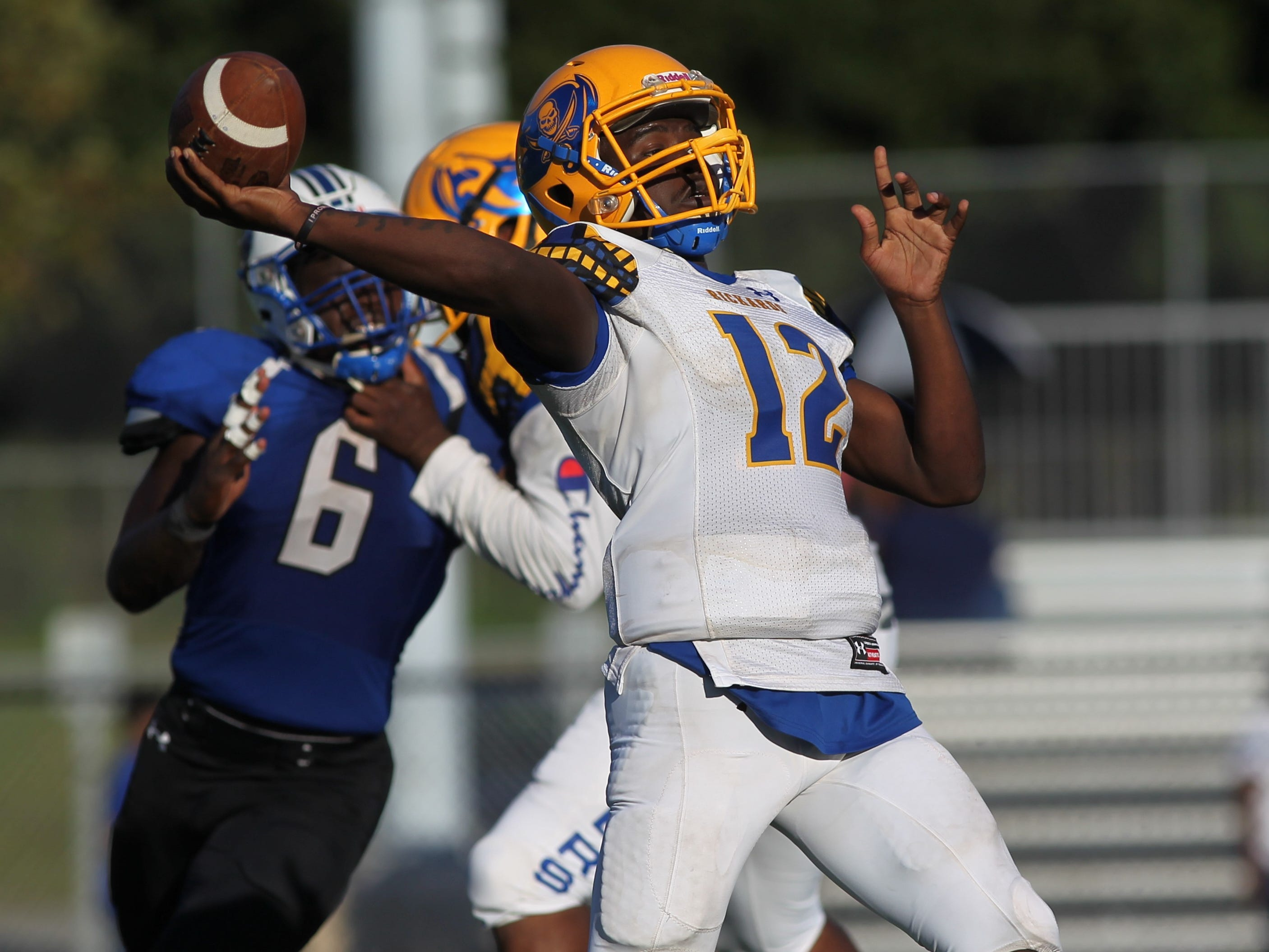 Rickards quarterback D'eryk Pete throws a pass downfield against Godby.