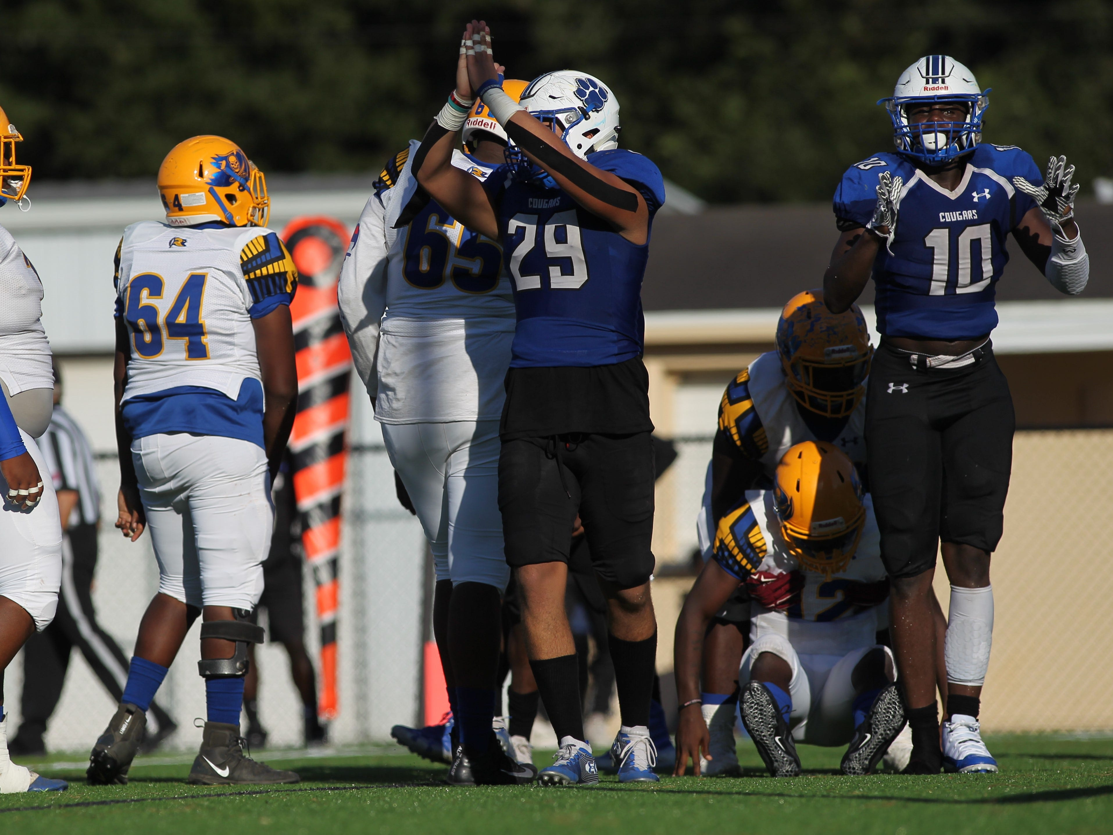 Godby's Kyler Laing and Cortez Andrews celebrate a safety against Rickards.