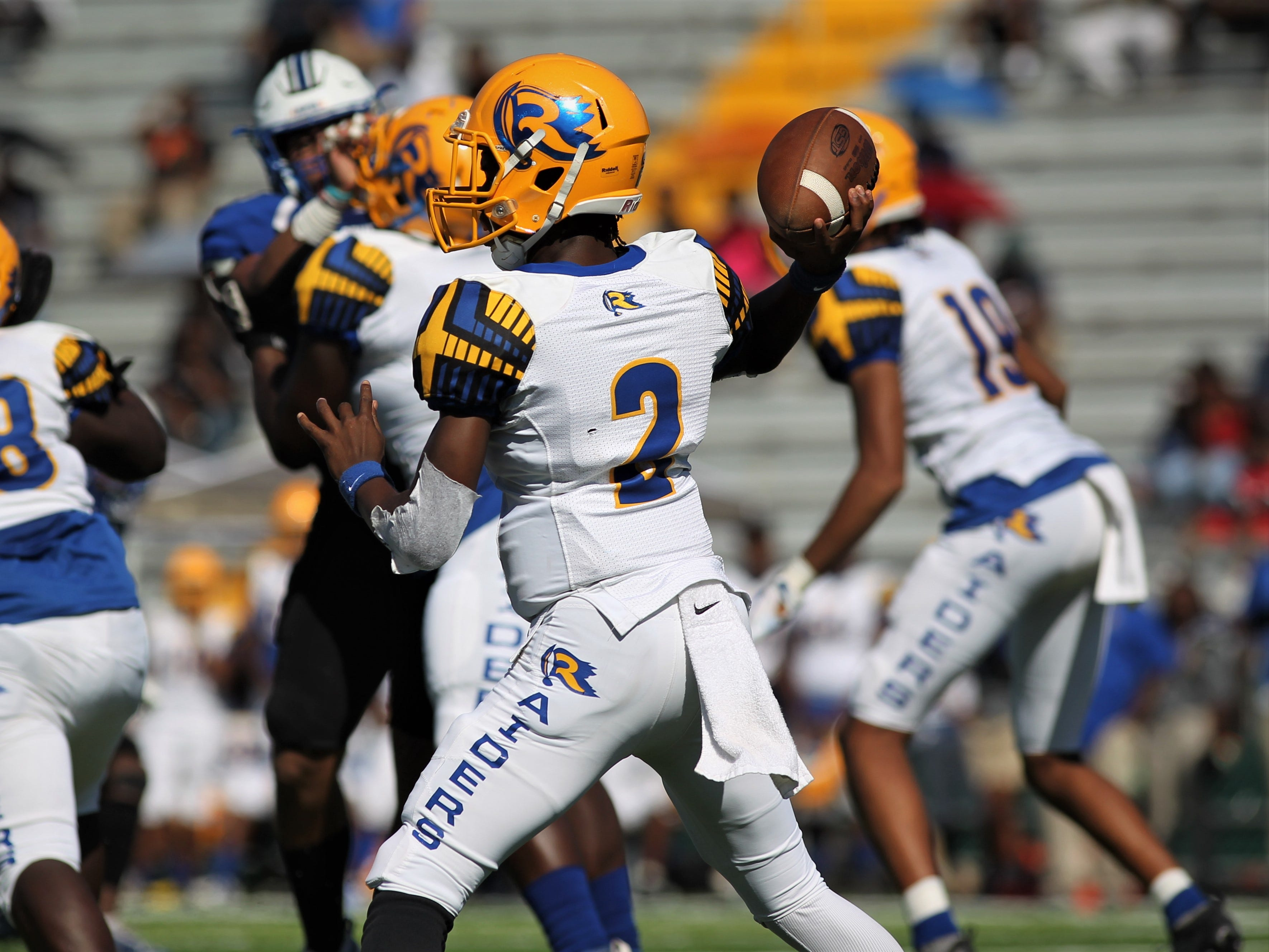 Rickards quarterback Greg Winters throws a pass against Godby.
