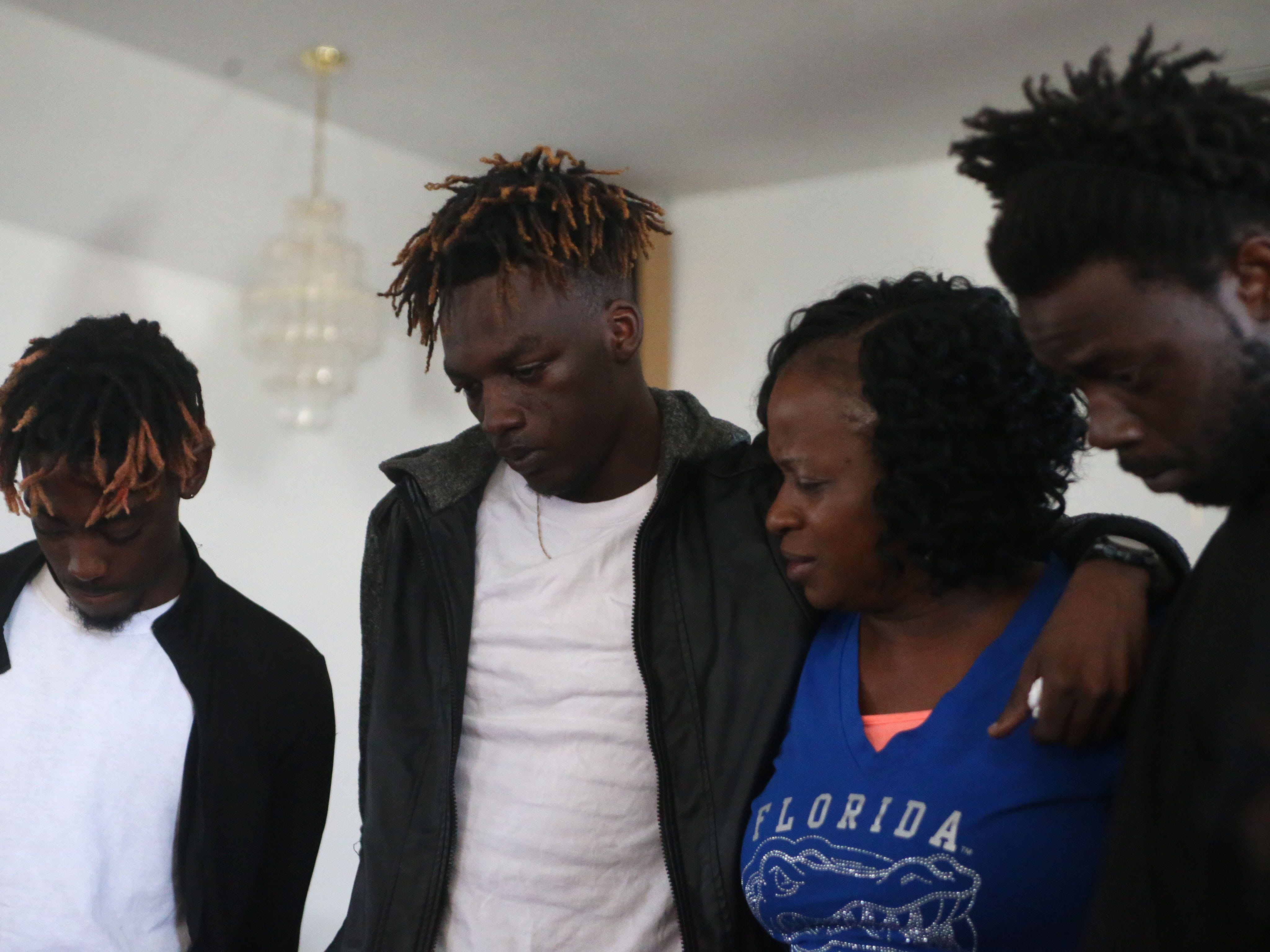 Family of Demashell Bass, a woman who could not receive medical attention and died during the hurricane from left to right, Tyran Grant, 21, son, Tyrone Grant, 23, son, Isabella Dubose, 54, aunt, and Lawrence Williams, 33, brother fight back tears at the Dream, Vision, and Destiny (DVD) Ministry in Gretna, Fla., on Sunday Oct. 14, 2018, after Hurricane Michael hits the Florida panhandle.