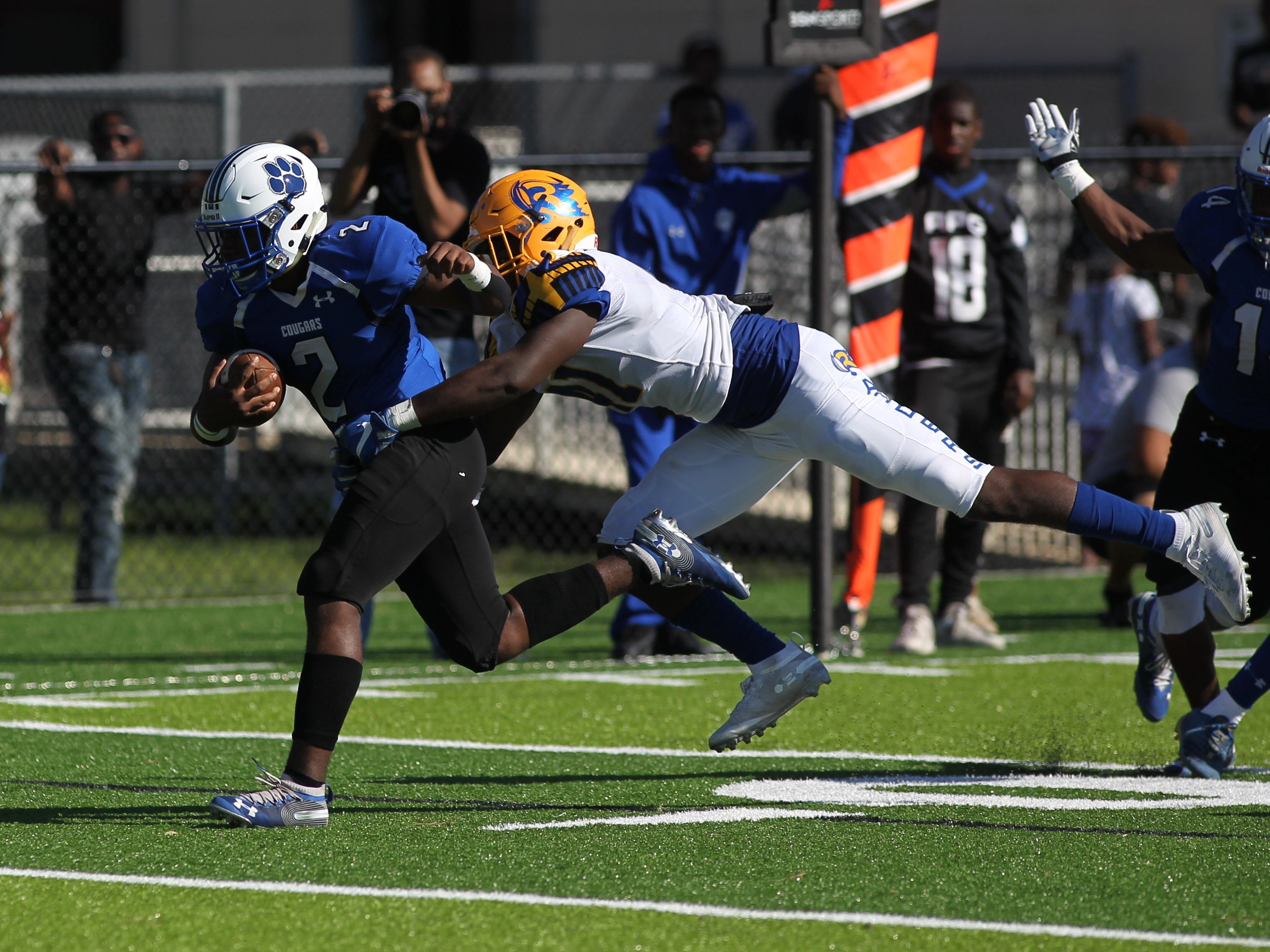 Godby running back Tony Street carries for a 15-yard touchdown run against Rickards.