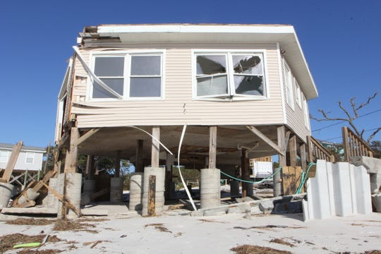 Beach erosion has left pilings exposed on many houses on Alligator Point after Hurricane Michael.