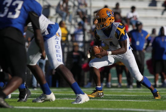 Rickards running back Kelvin Dean takes off on a short touchdown run against Godby.