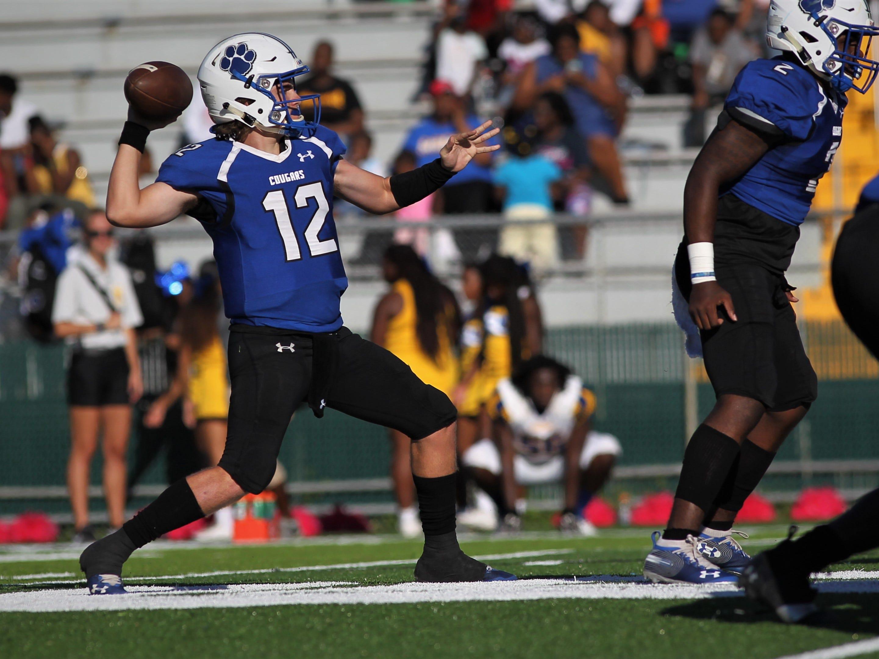 Godby quarterback Trey Fisher throws a deep pass against Rickards.