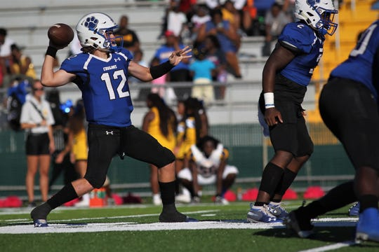 Godby quarterback Trey Fisher throws a deep pass against Rickards.