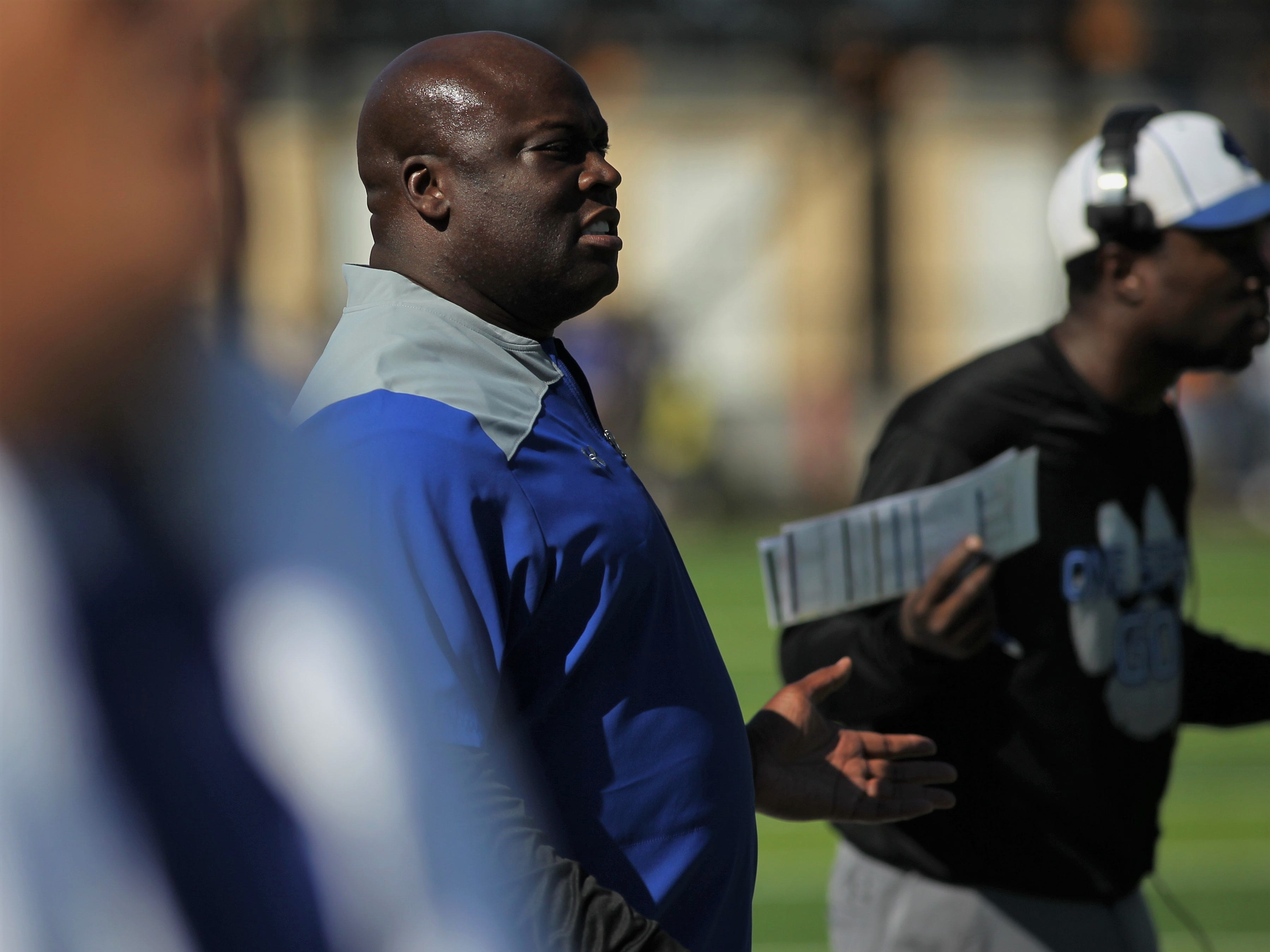 Godby football coach Corey Fuller watches angrily at referee calls during Saturday's game against Rickards.