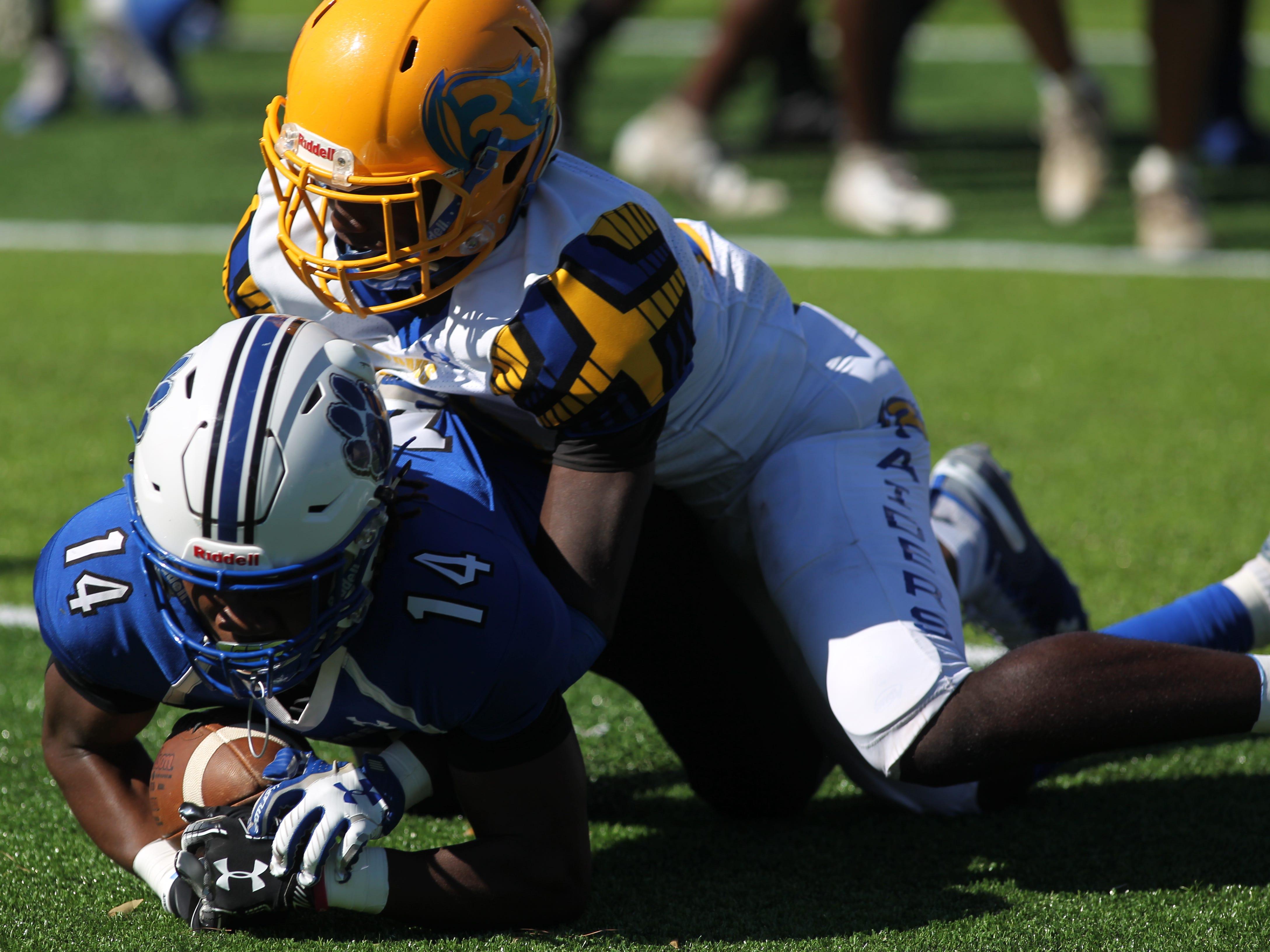 Godby receiver Ja'heim Knight catches a 5-yard touchdown pass against Rickards.