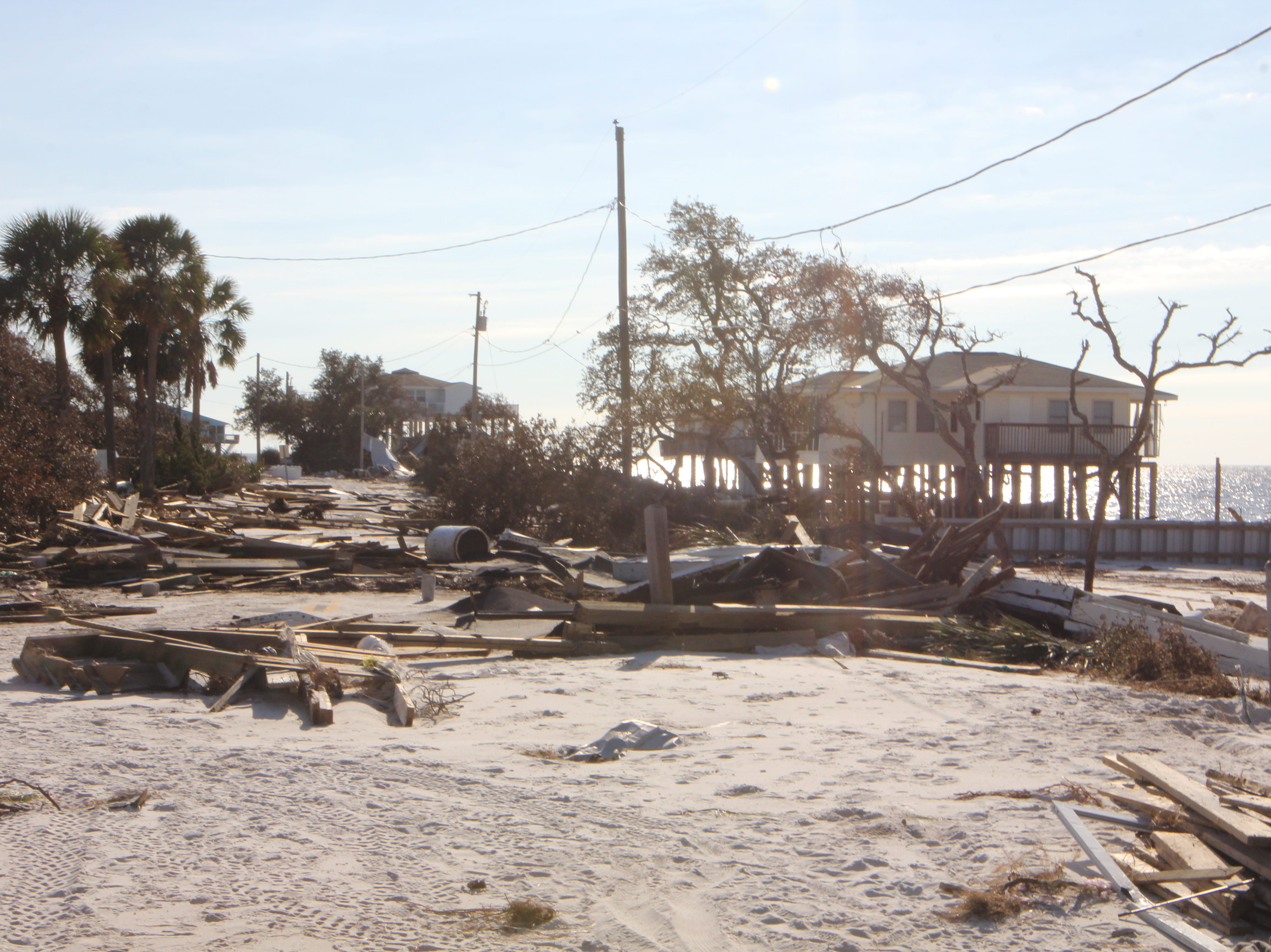Houses sit in ruins on Alligator Point after Hurricane Michael.