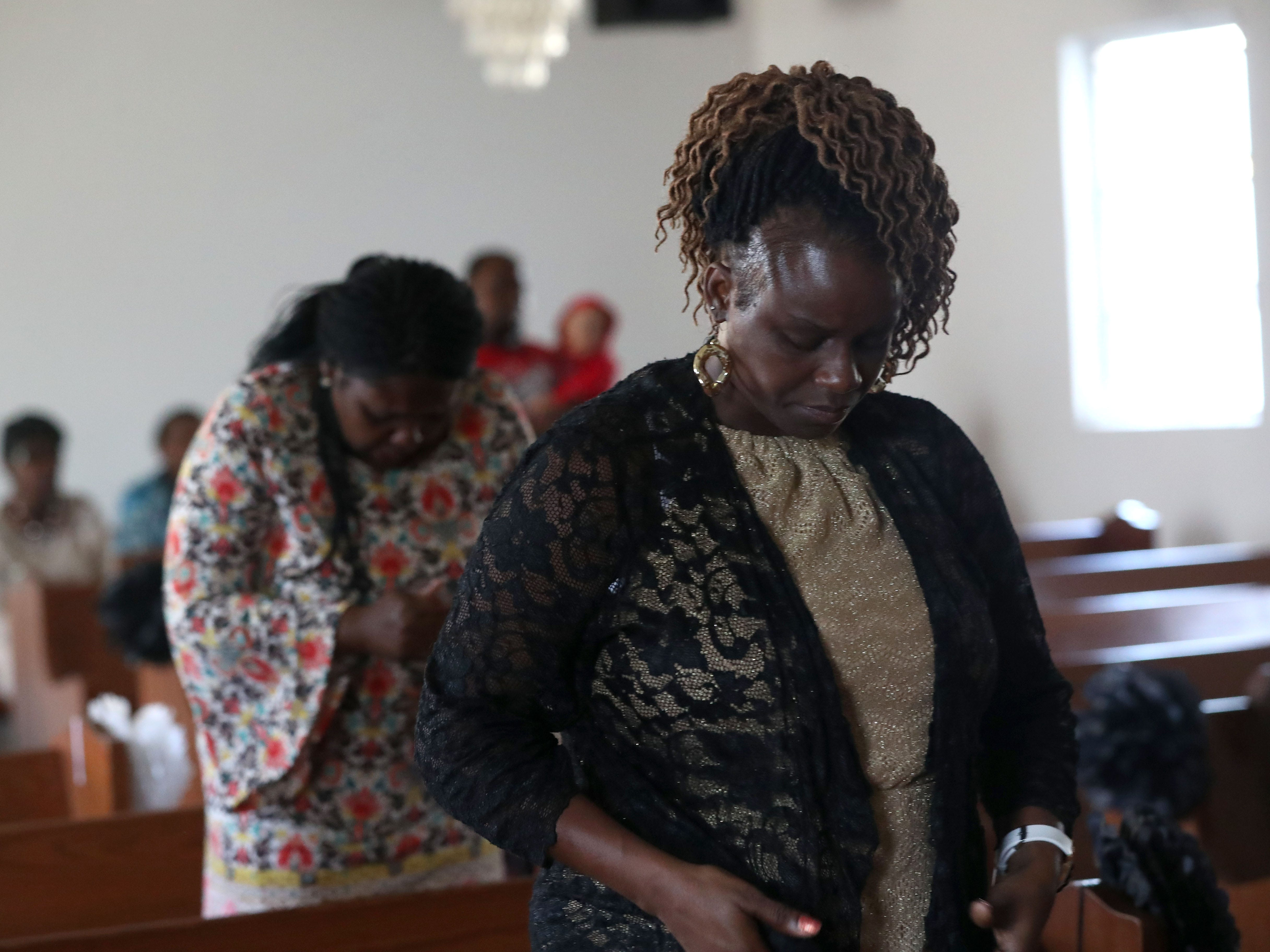Members of the Dream, Vision, and Destiny (DVD) Ministry in Gretna, Fla., take a moment to pray at Sunday service on Oct. 14, 2018, after Hurricane Michael hits the Florida panhandle.