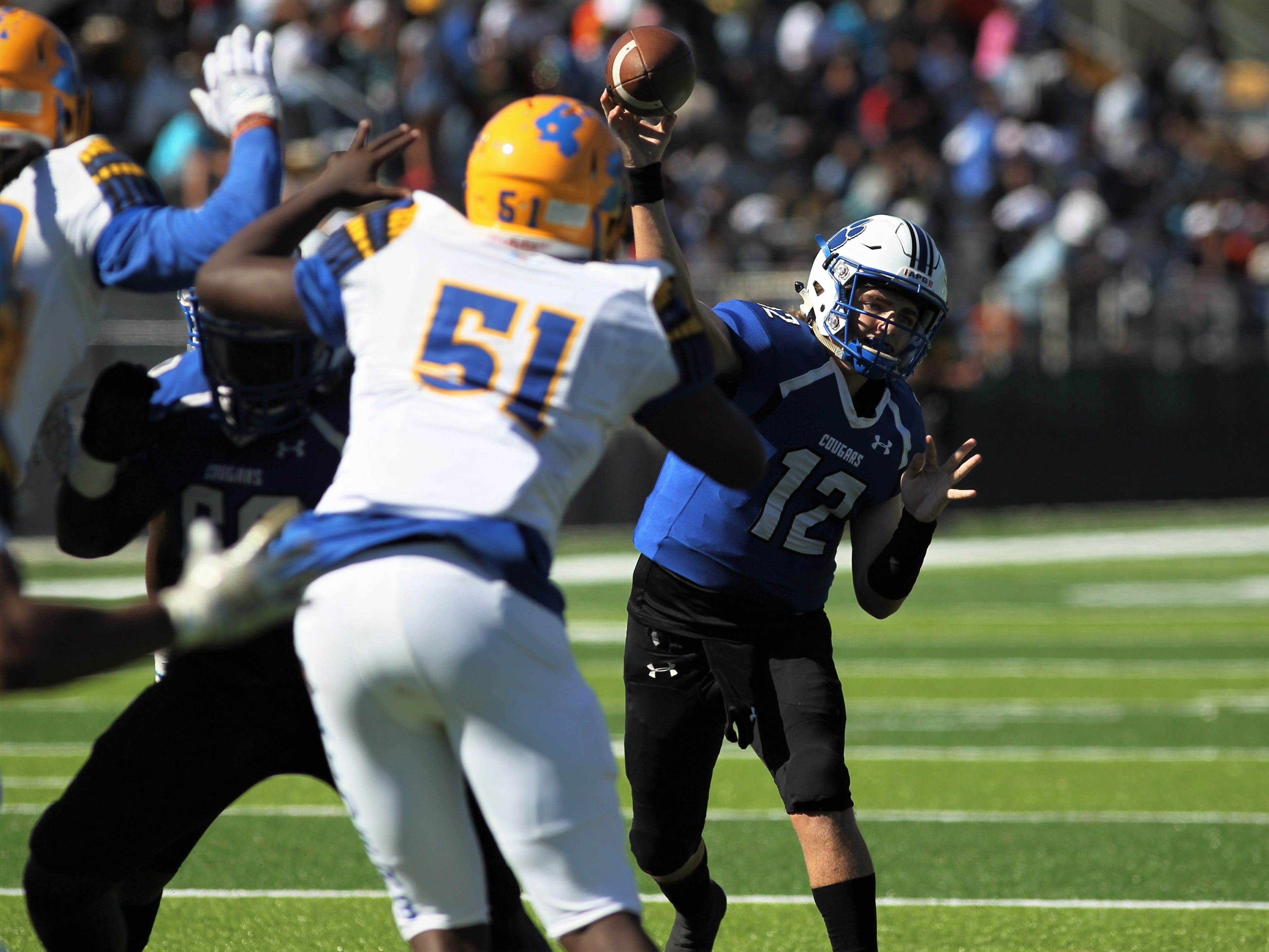 Godby quarterback Trey Fisher throws a pass against Rickards.