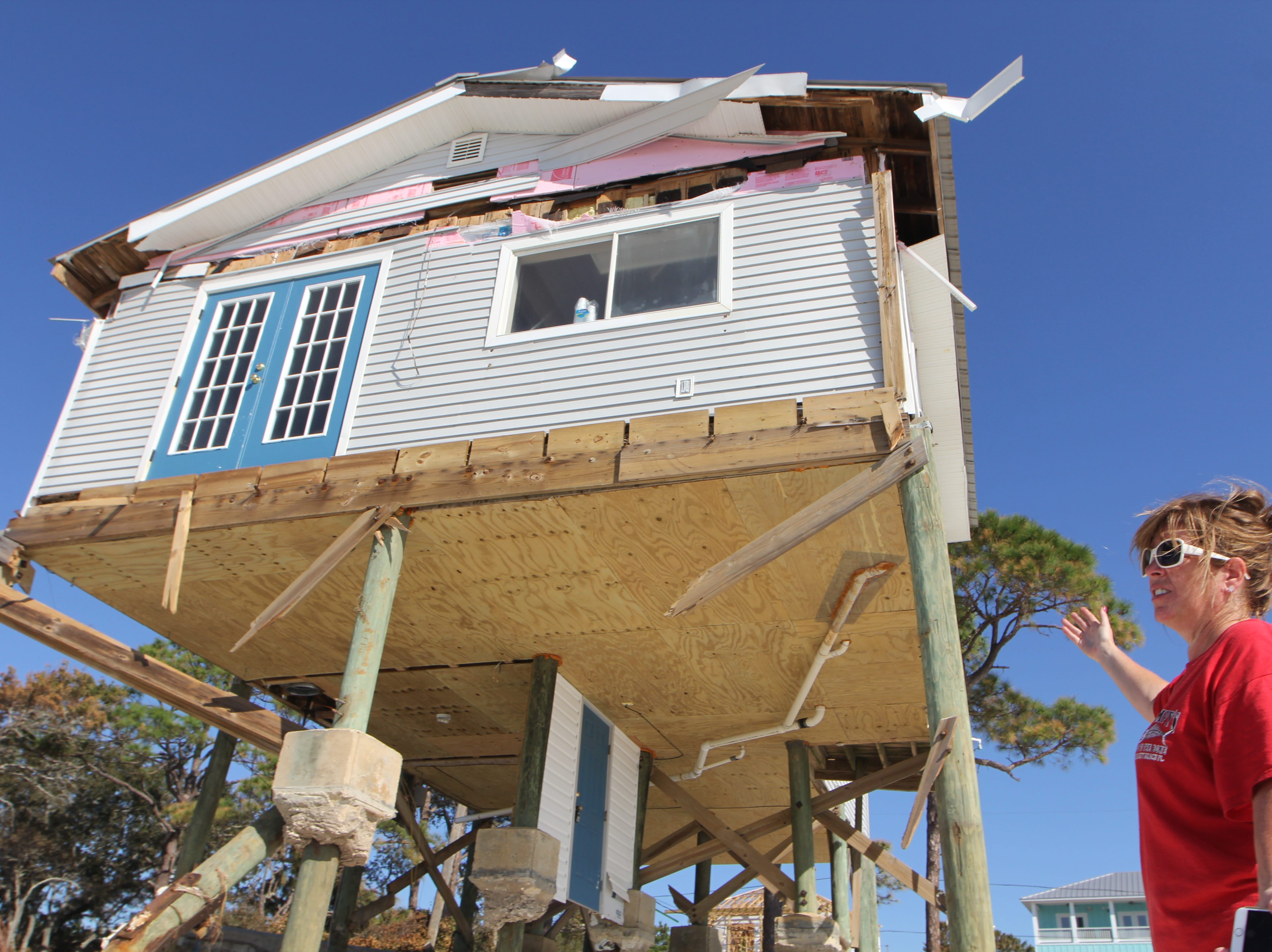 Tonia McNabb's house on Alligator Point sustained major damage during Hurricane Michael. The entire porch is gone.