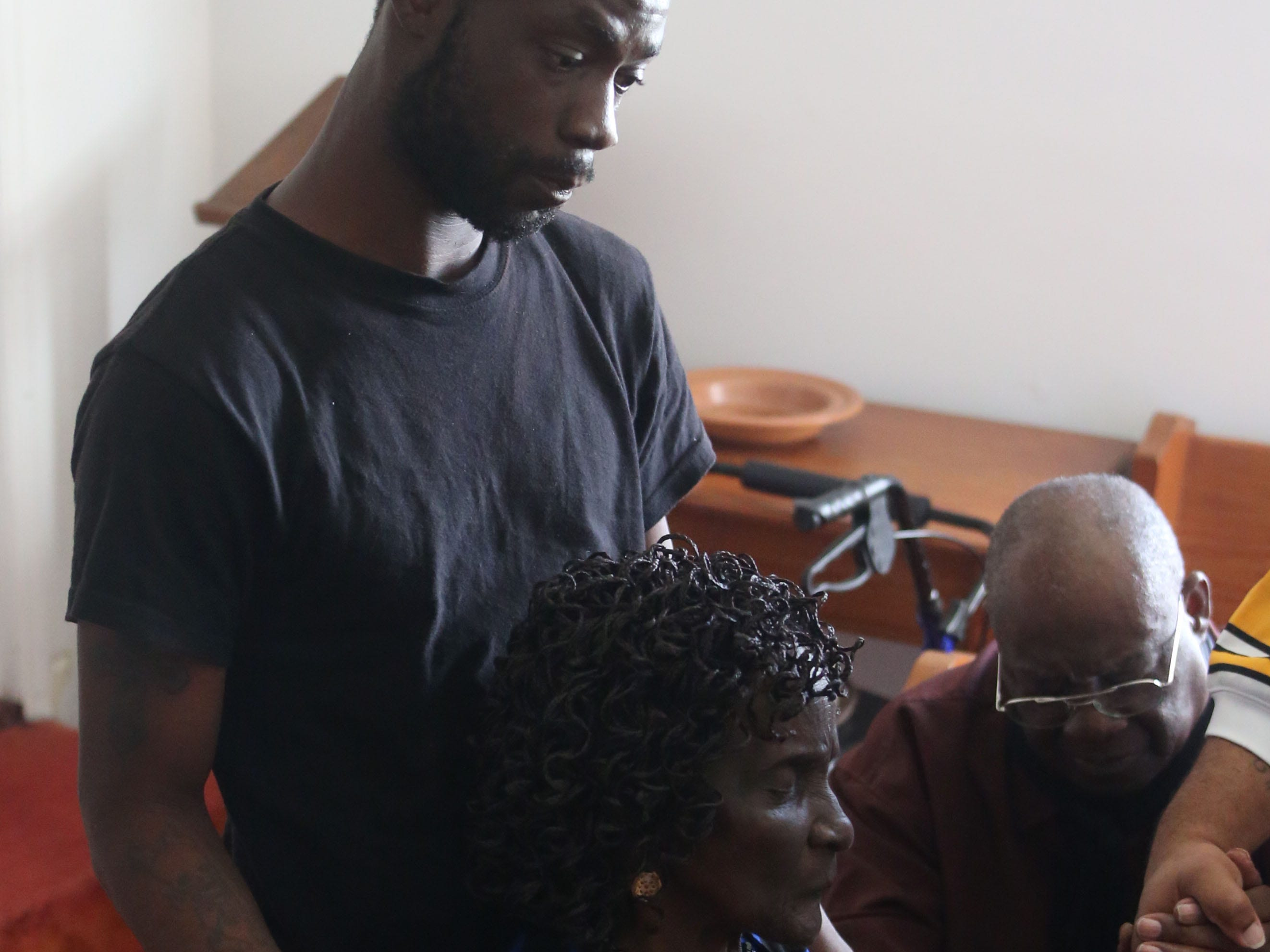 Tyrone Grant, son, 23, left, consoles Dollies Alls, 81, grandmother of Demashell Bass, a woman who could not receive medical attention and died during the hurricane at the Dream, Vision, and Destiny (DVD) Ministry in Gretna, Fla., on Sunday Oct. 14, 2018, after Hurricane Michael hits the Florida panhandle.