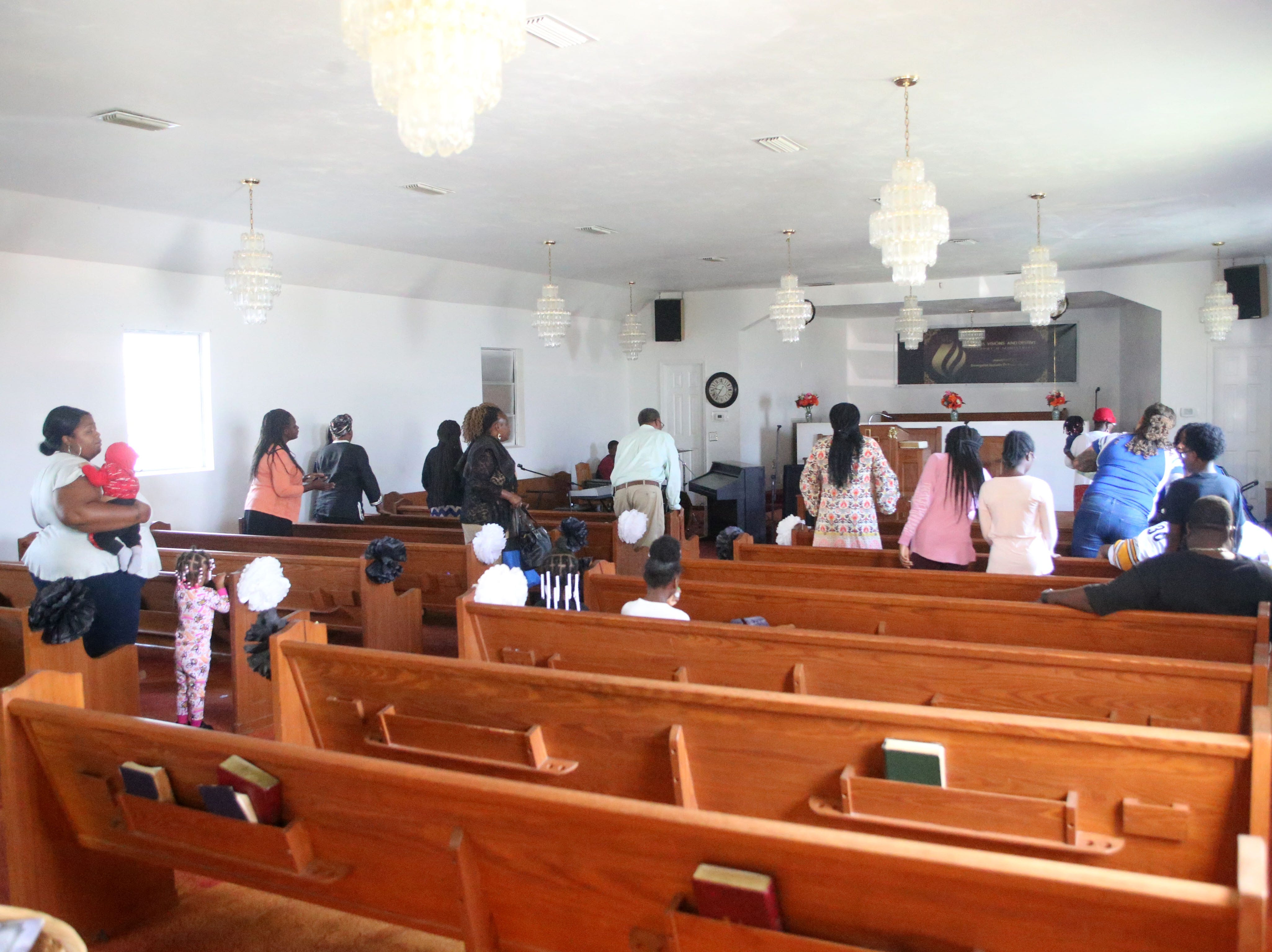 Members of Dream, Vision, and Destiny (DVD) Ministry in Gretna, Fla., worship and sing songs of praise on Sunday Oct. 14, 2018, after Hurricane Michael hits the Florida panhandle.
