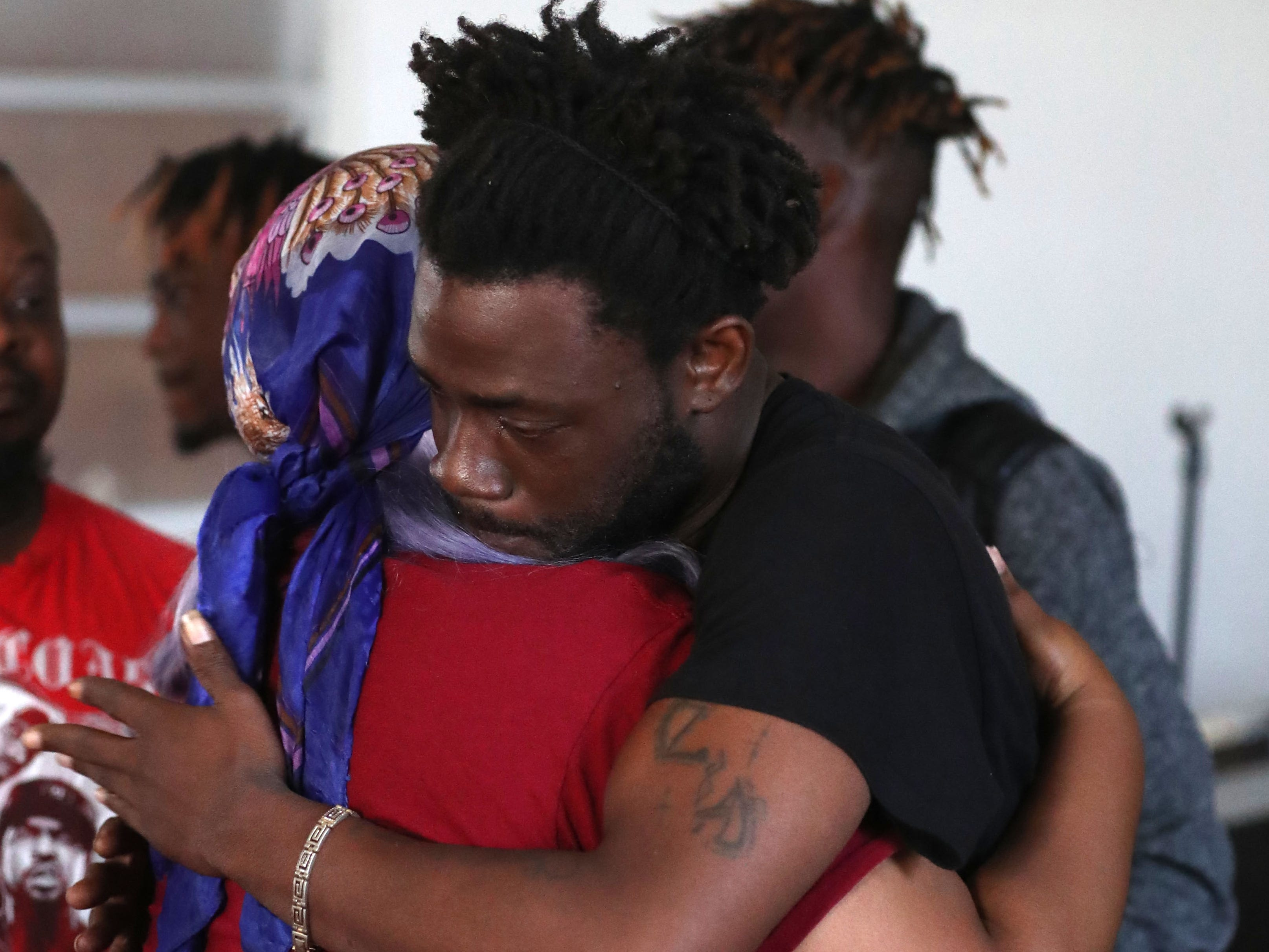Lawrence Williams, brother of Demashell Bass, a woman who could not receive medical attention and died during the hurricane, 33, receives condolences from a church member at the Dream, Vision, and Destiny (DVD) Ministry in Gretna, Fla., on Sunday Oct. 14, 2018, after Hurricane Michael hits the Florida panhandle.