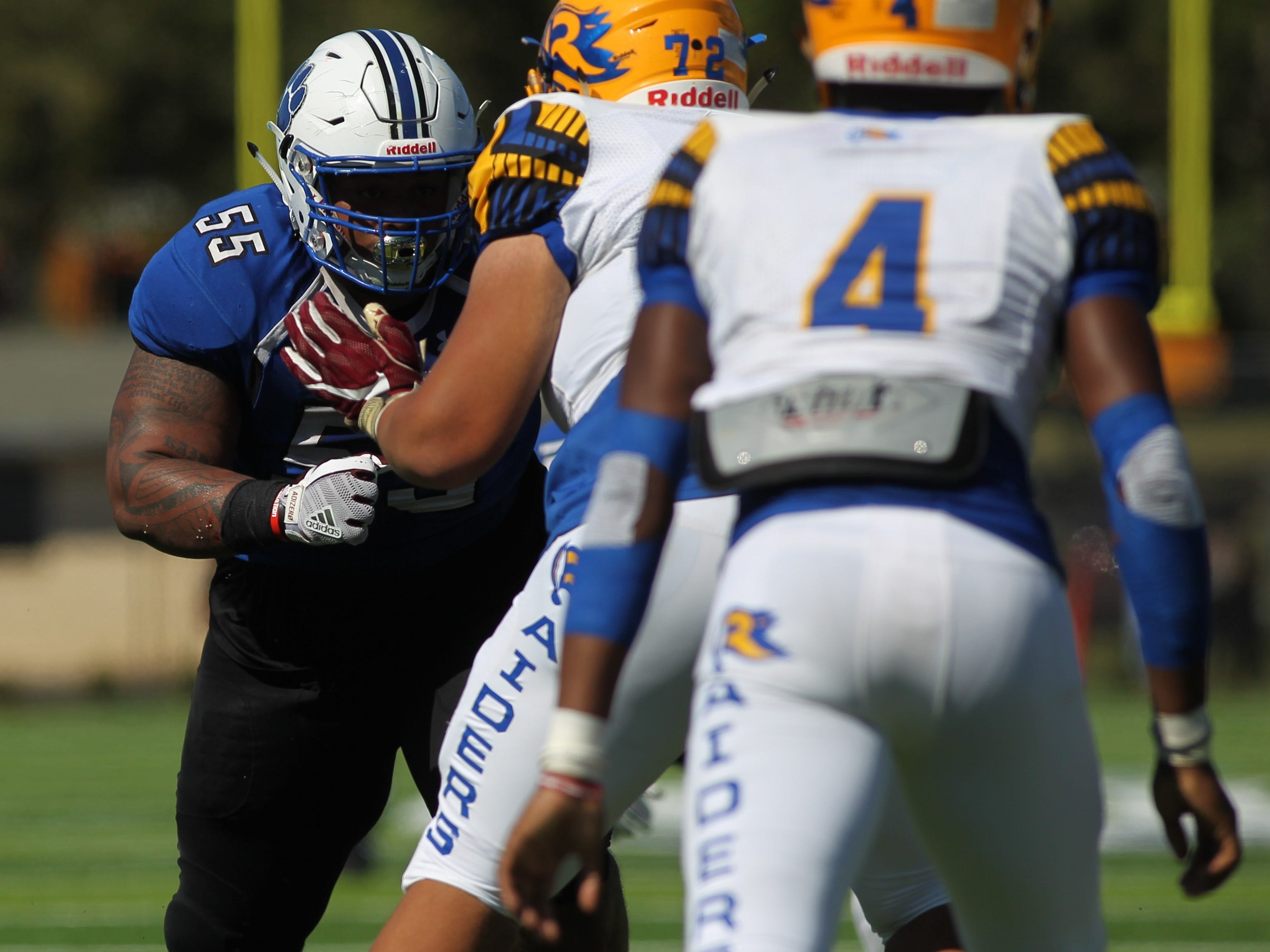 Godby defensive tackle Quentin Jones takes on Rickards blockers.