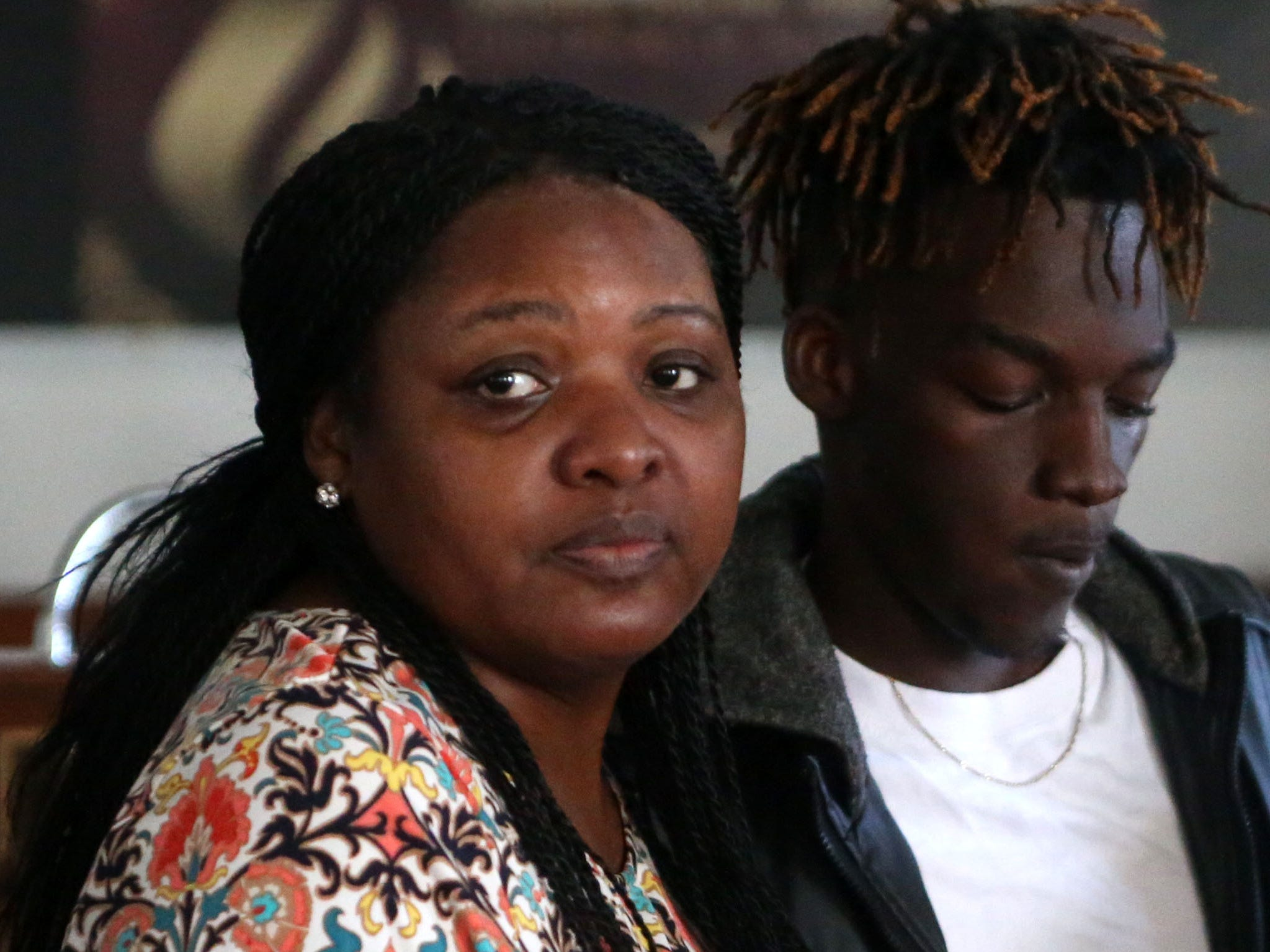 Delisha Green, friend, left, tries to console Tyrone Grant, right, son of Demashell Bass, a woman who could not receive medical attention and died during the hurricane at the Dream, Vision, and Destiny (DVD) Ministry in Gretna, Fla., on Sunday Oct. 14, 2018, after Hurricane Michael hits the Florida panhandle.