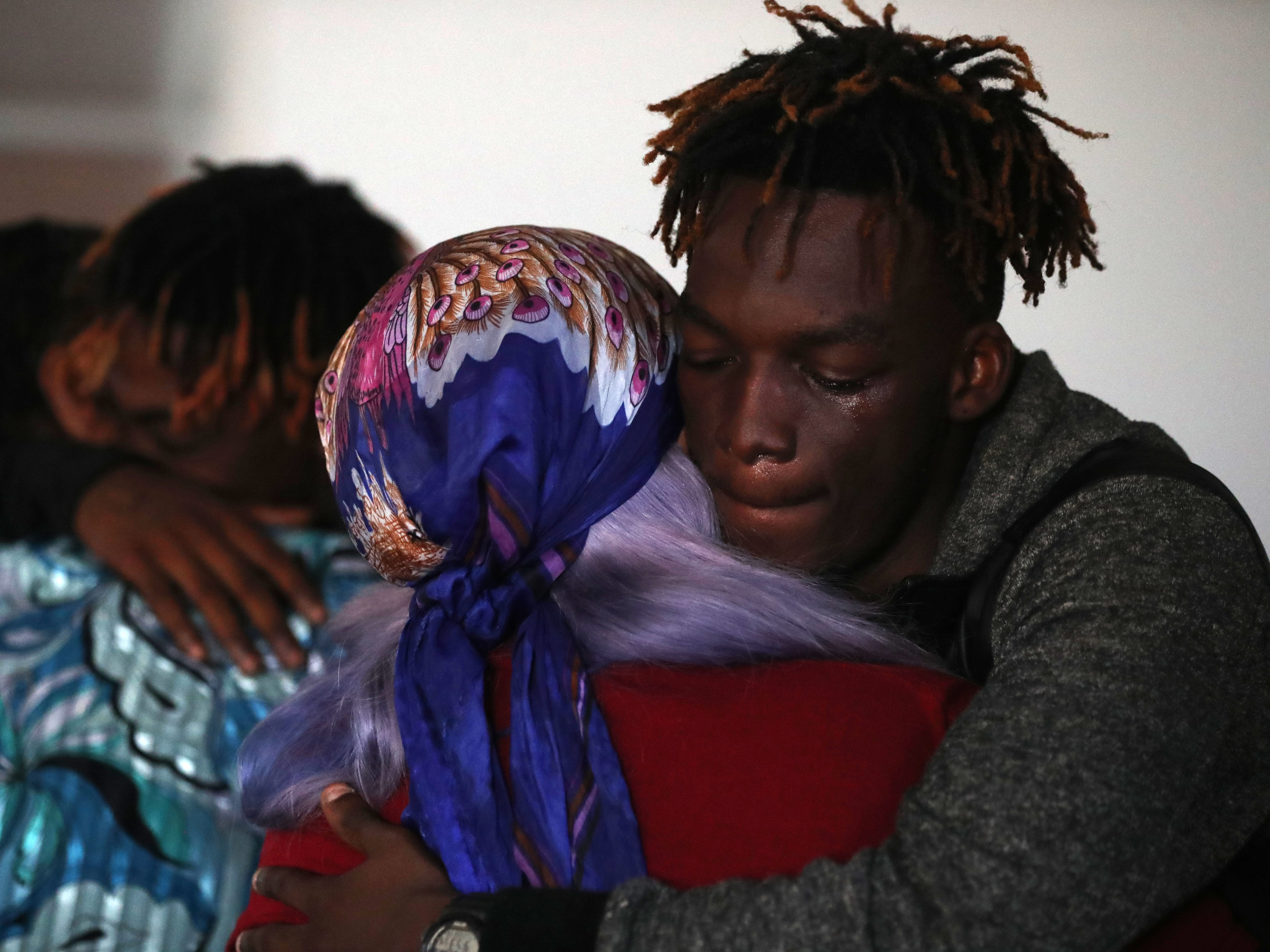 Tyrone Grant, son of Demashell Bass, a woman who could not receive medical attention and died during the hurricane, receives condolences from a member of the Dream, Vision, and Destiny (DVD) Ministry in Gretna, Fla., on Sunday Oct. 14, 2018, after Hurricane Michael hits the Florida panhandle.