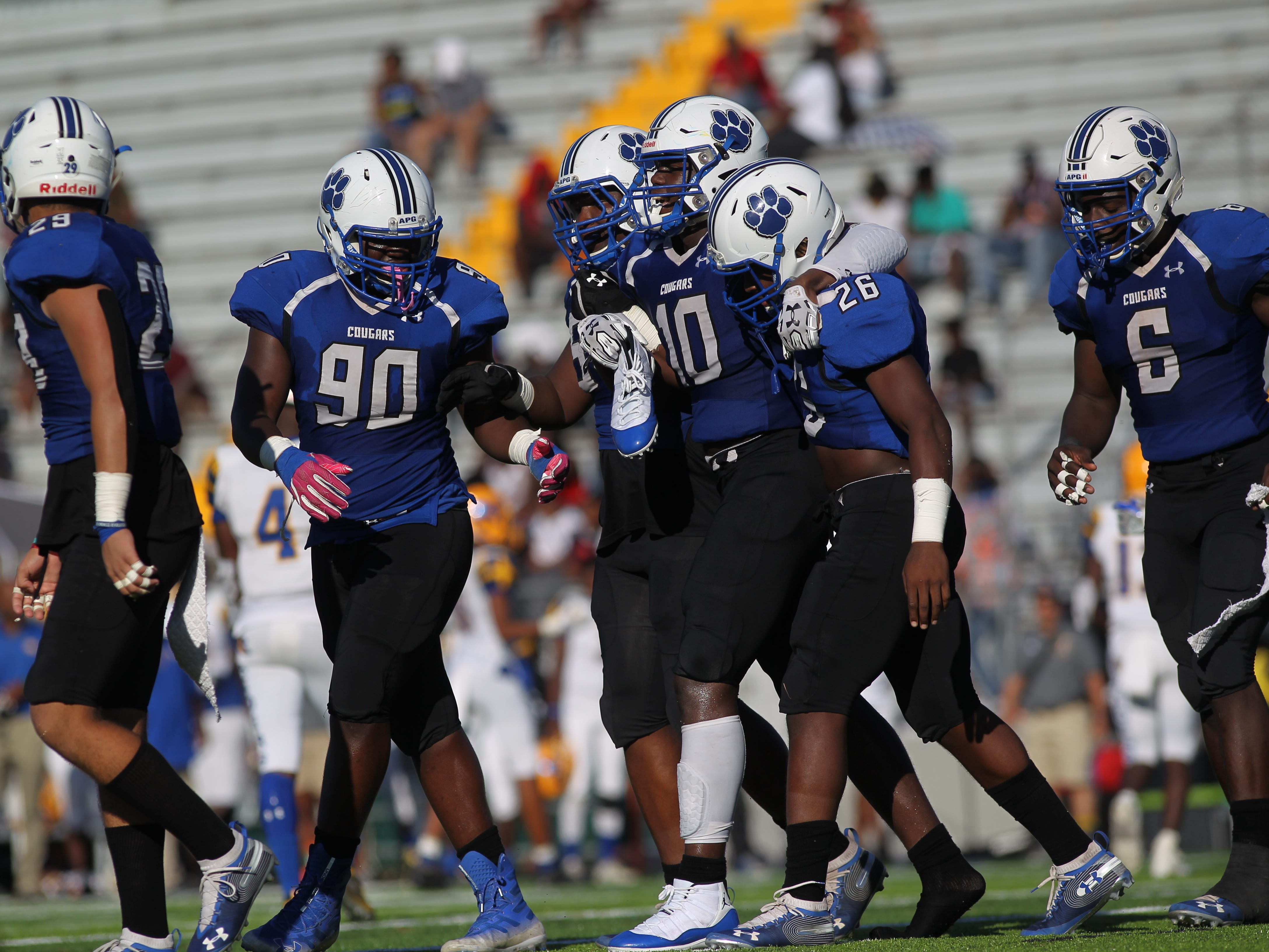 Godby's Cortez Andrews gets helped off the field after losing his shoe and suffering cramps during Saturday's game against Rickards.