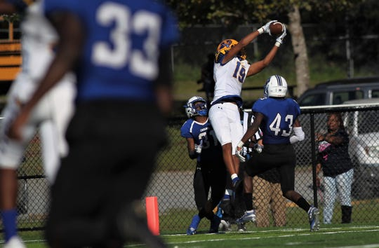 Rickards receiver Malik Miller skies for a 30-yard touchdown catch against Godby.