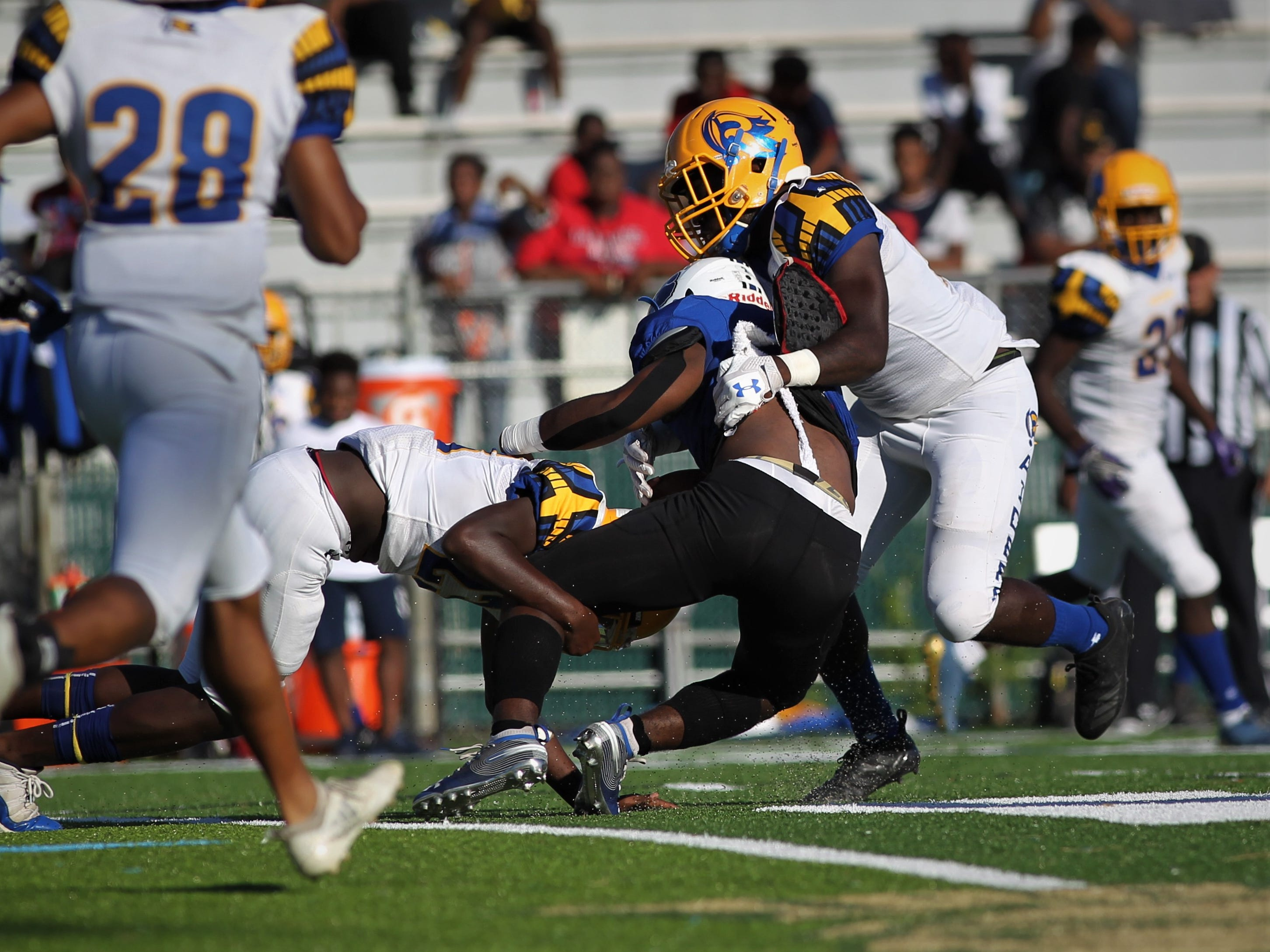 The Godby Cougars face the Rickards Raiders in a high school football game at Gene Cox Stadium on Saturday, Oct. 13, 2018.