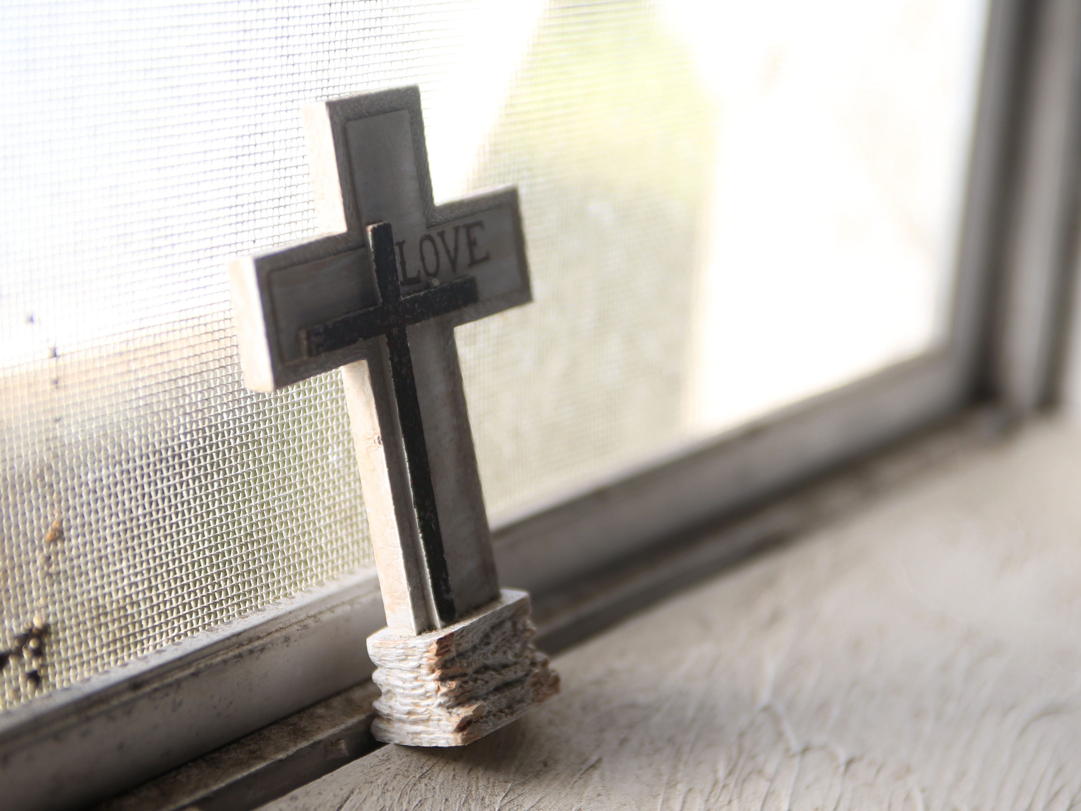 A cross stands in each windowsill at Dream, Vision, and Destiny (DVD) Ministry in Gretna, Fla., on Sunday Oct. 14, 2018, after Hurricane Michael hits the Florida panhandle.